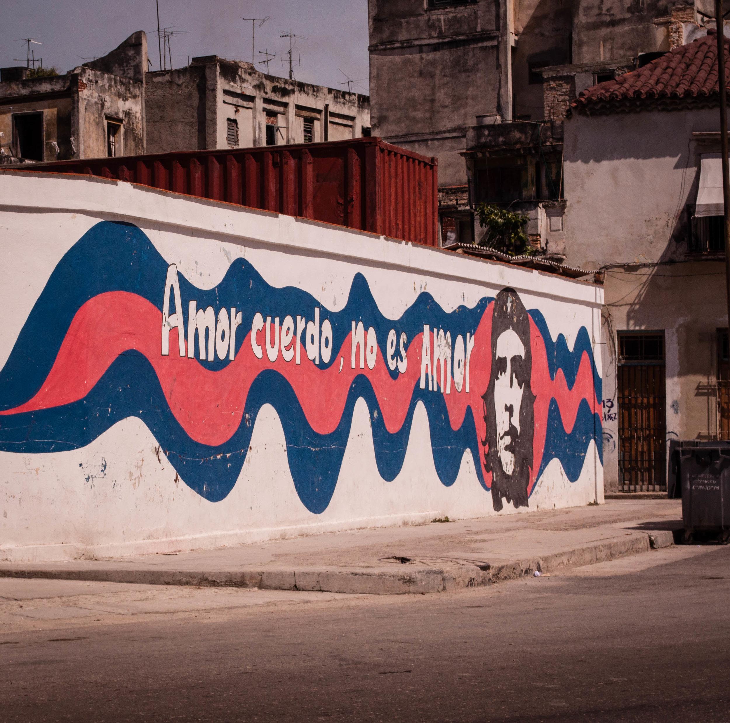 Slogan of Che Guevara with his portrait on a wall in La Havana