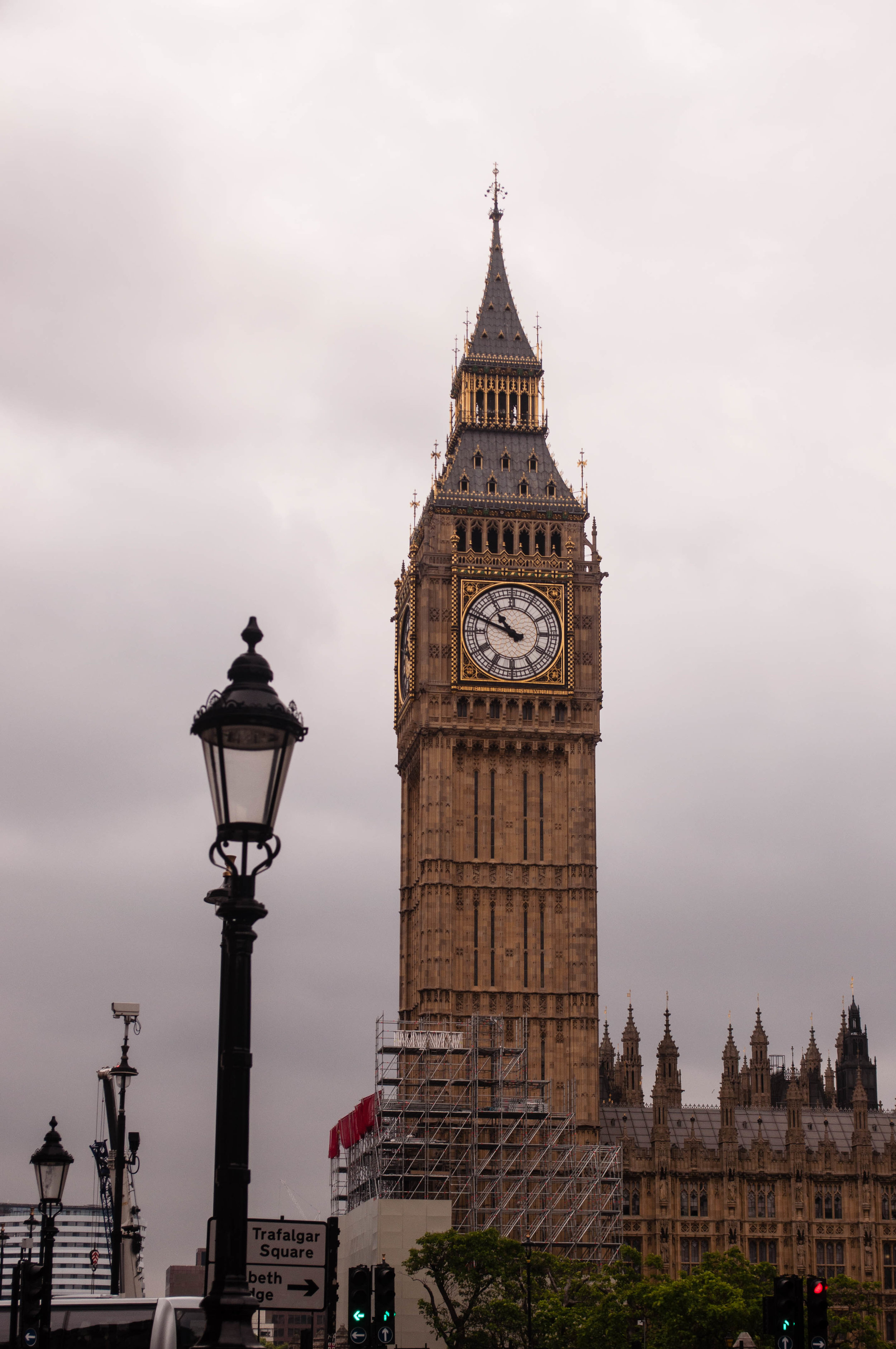 Big Ben in London and lamp post. This landmark can be seeing during a long layover in London (UK)