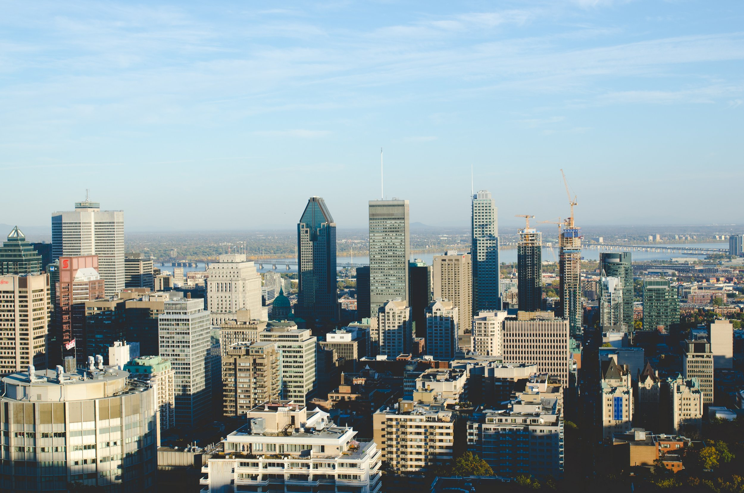 Photo of Montreal skyline by  andrew welch  on  Unsplash