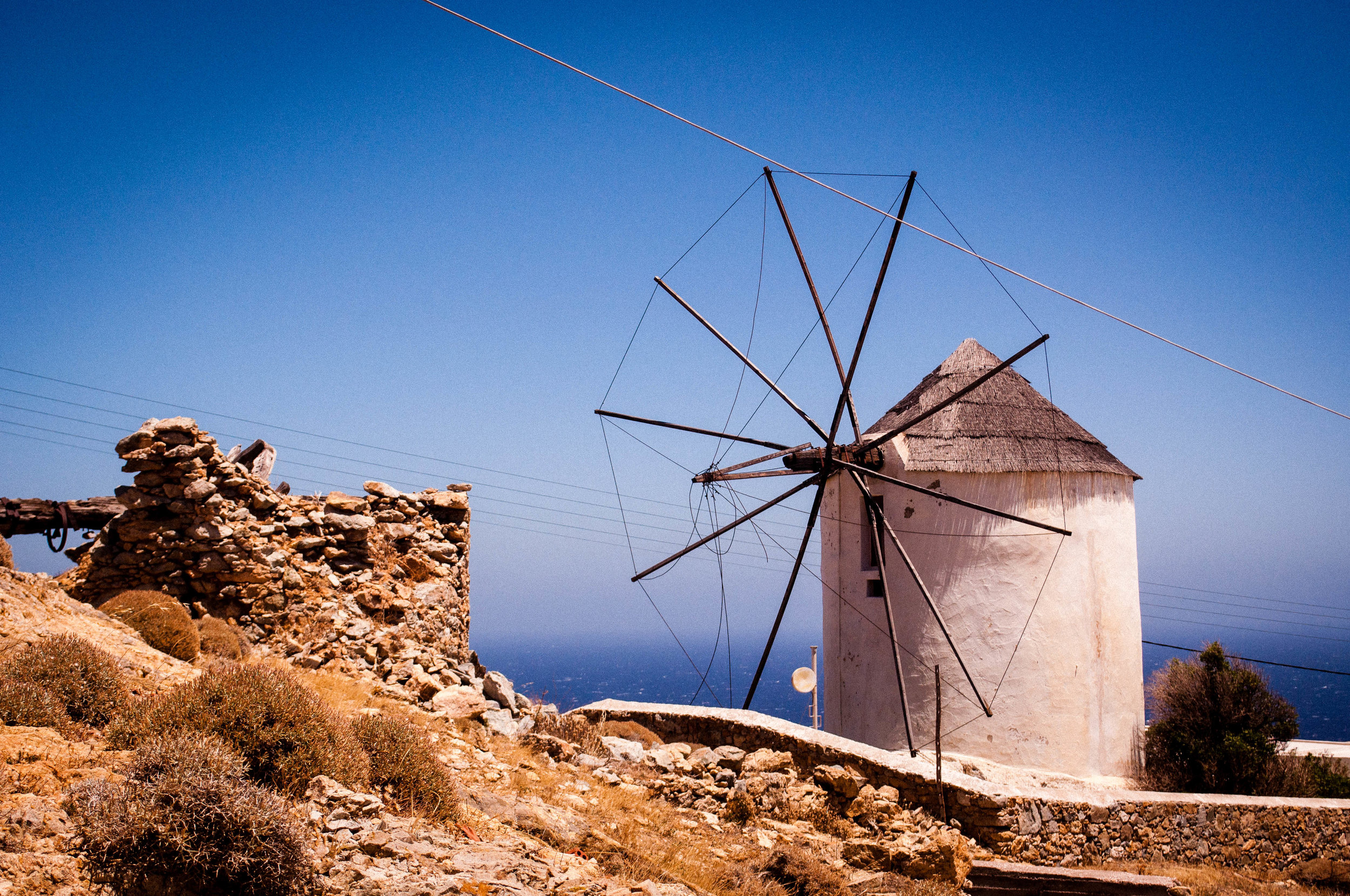 White wind mill of Serifos with a blue sky on the backdrop