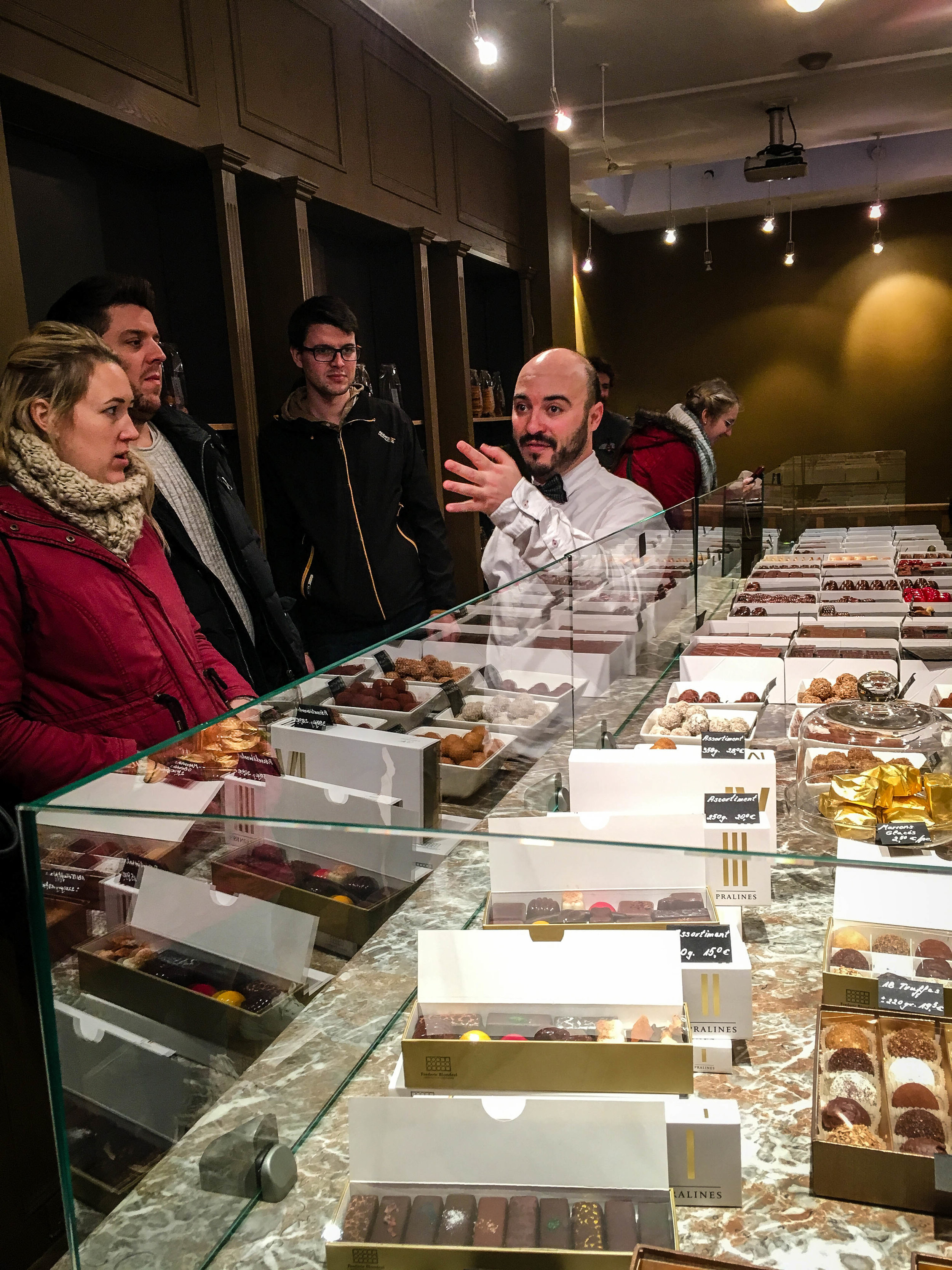 Explanation by the tour guide of the Brussels Journey in our Brussels Beer and Chocolate Tour