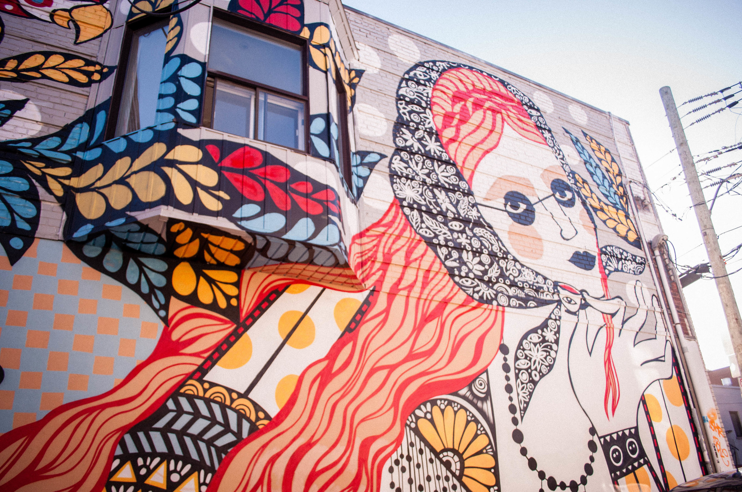 A graffiti on Saint-Viateur Street (Montreal) of Eastern European style with a women. Graffiti proposed as the best street art in Montreal