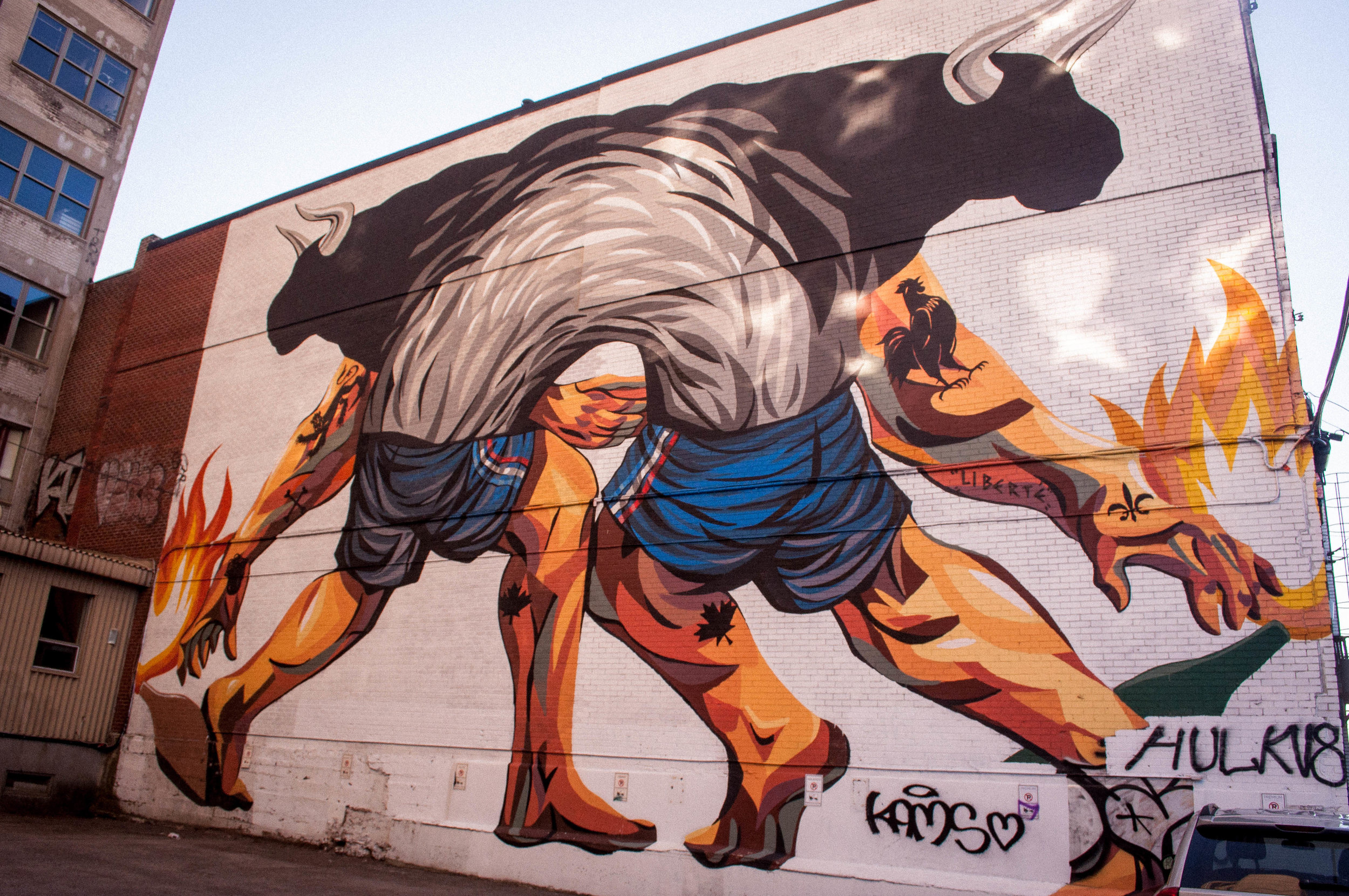 Graffiti on rue Saint-Dominique (Montreal) of half-men and half-bull. Graffiti proposed as the best street art in Montreal