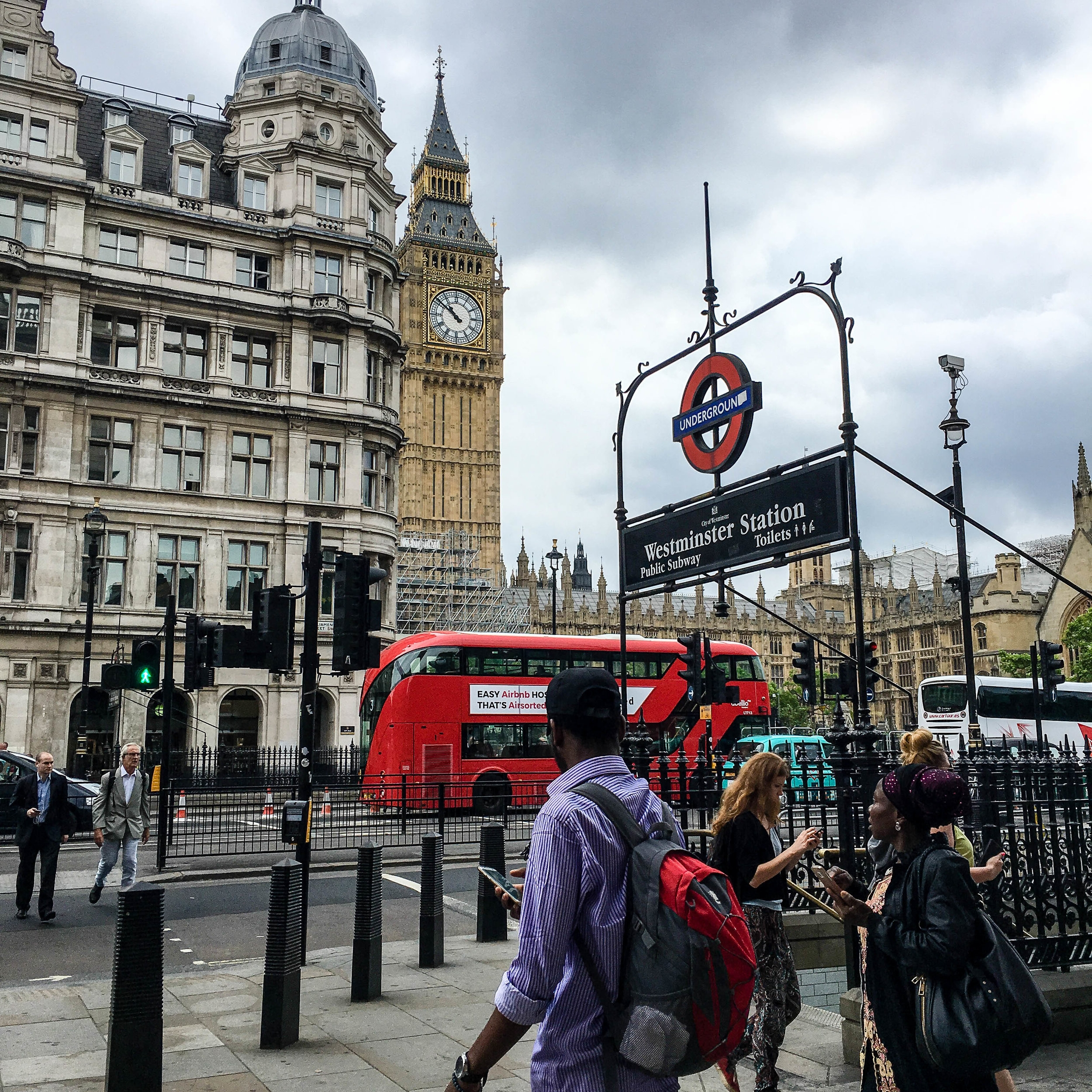 Big ben, Westminister subway station and red double decker buses in London. This landmark can be seeing during a long layover in London (UK). Sightseeing in 8 hour layover in London