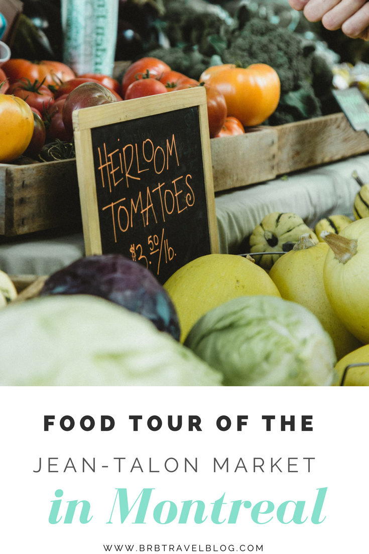 "Pinterest optimized image with text ""Food tour of the Jean-Talon Market in Montreal"" with an image of tomatos"