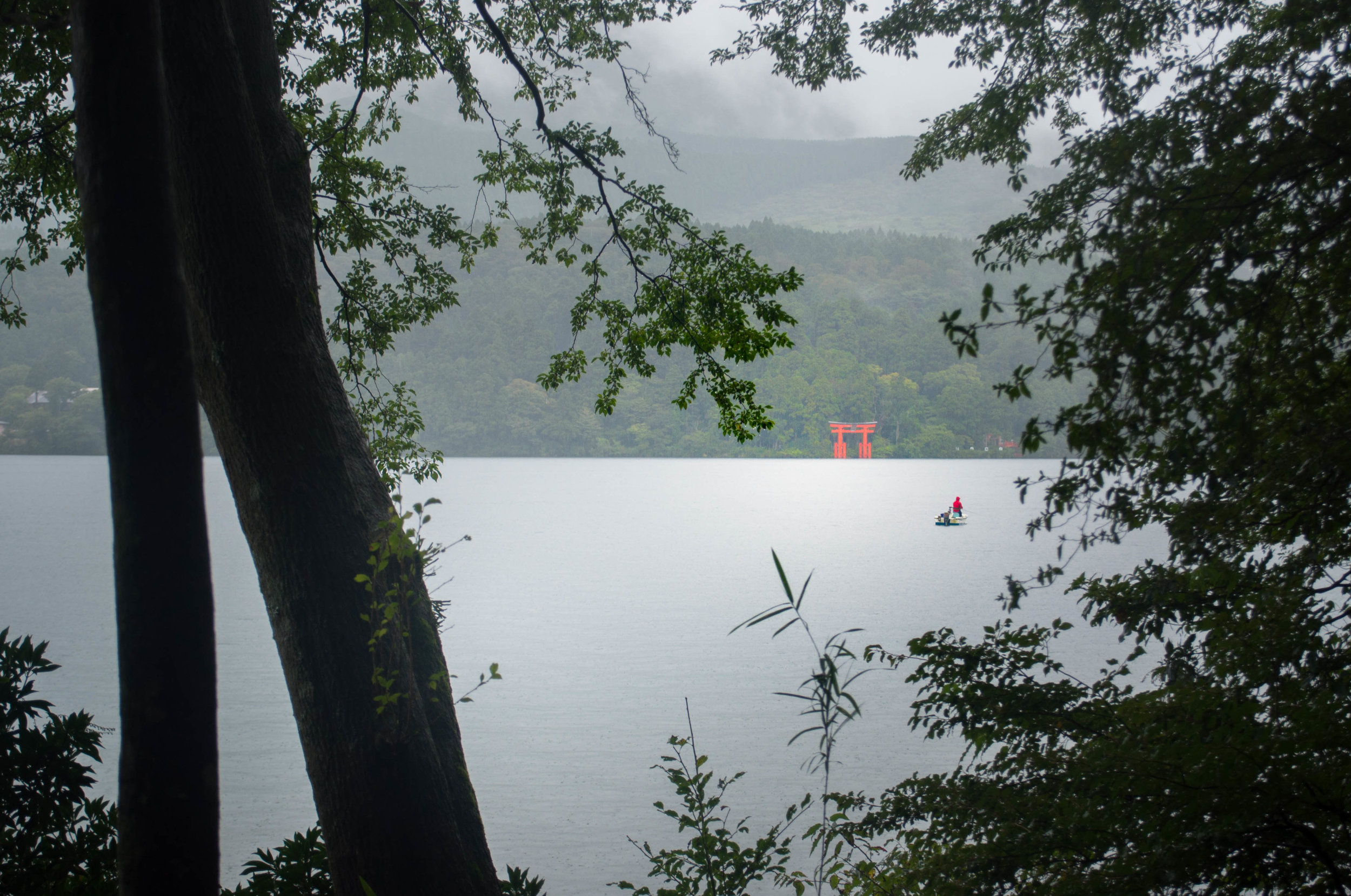 Red Torii on Ashi Lake in Hakone, a day trip from Tokyo. Part of Tokyo itinerary 7 days