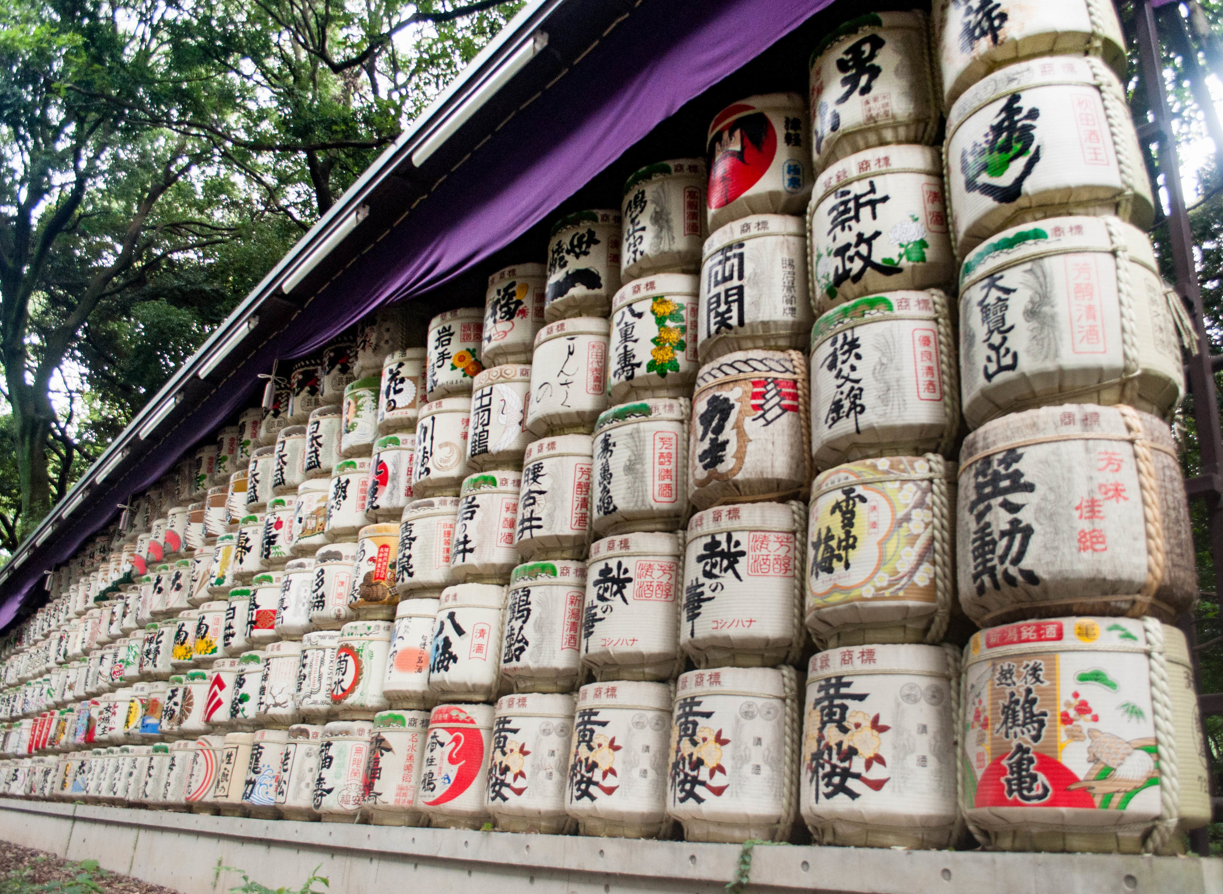 Sake barrels in Nada  sake district part of the itinerary for couples doing their honeymoon in Japan
