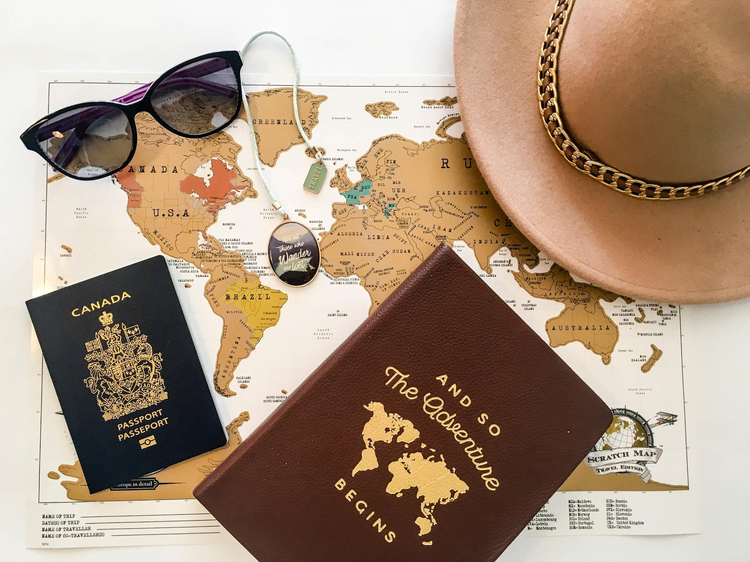 Vacation savings plan. Flat lay of a map, a passport, sunglasses, a hat ans a notebook