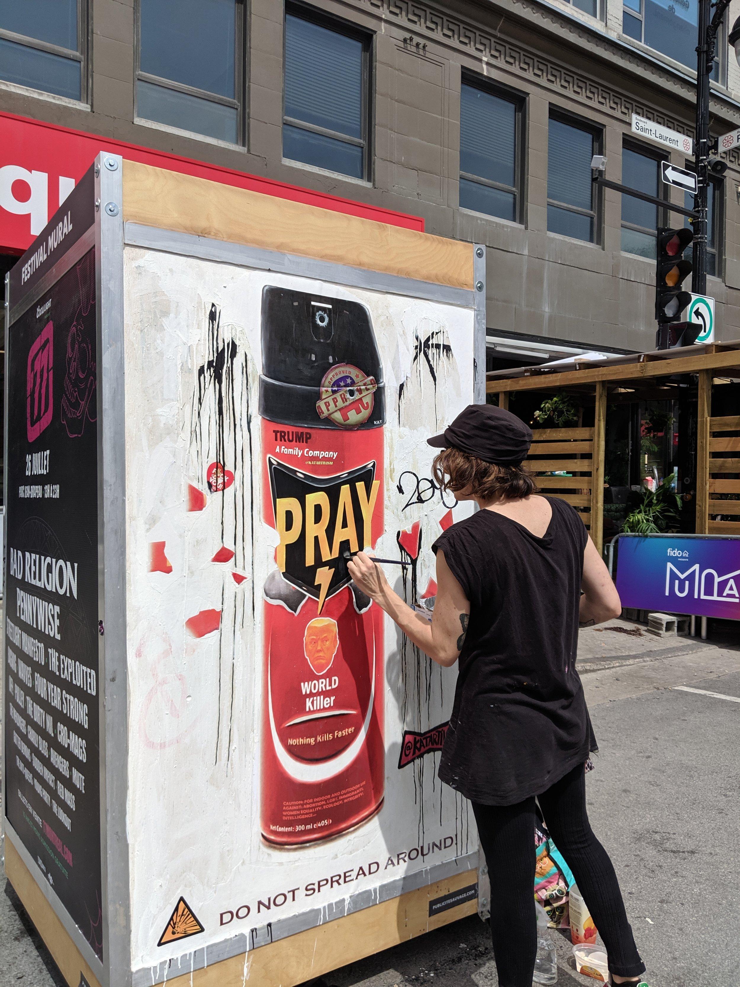 Artist doing street art at the Mural festival