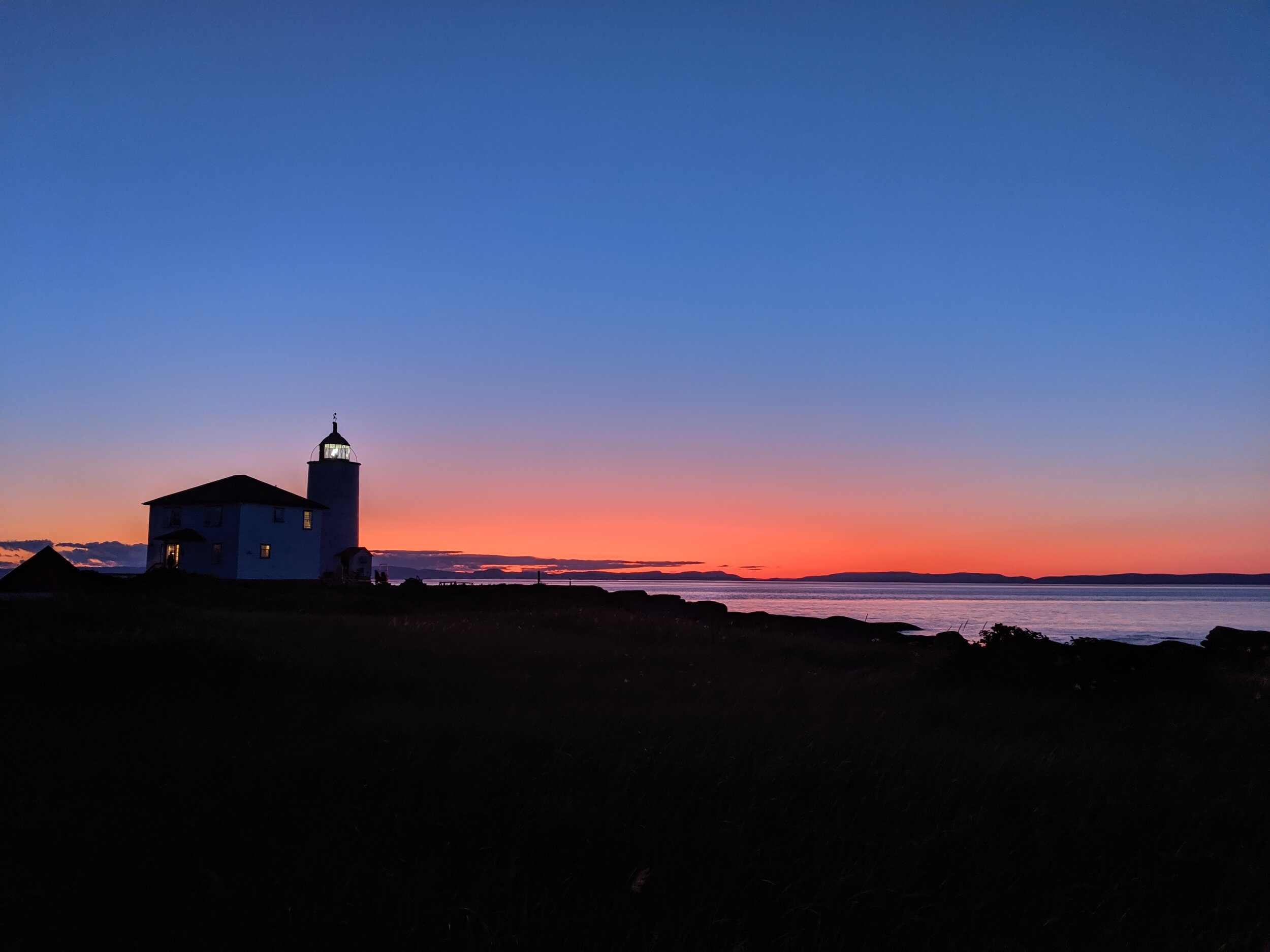 Sunset against Ile Verte lighthouse. Road trip in Gaspésie