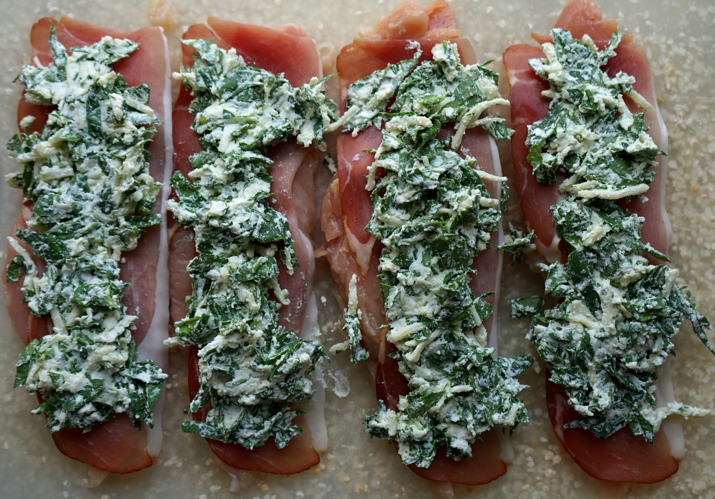 Chicken and prosciutto pinwheels are a delicious weeknight dinner or meal prep option. With creamy cheese and salty prosciutto stuffed inside some chicken breast it makes for a comforting dinner.