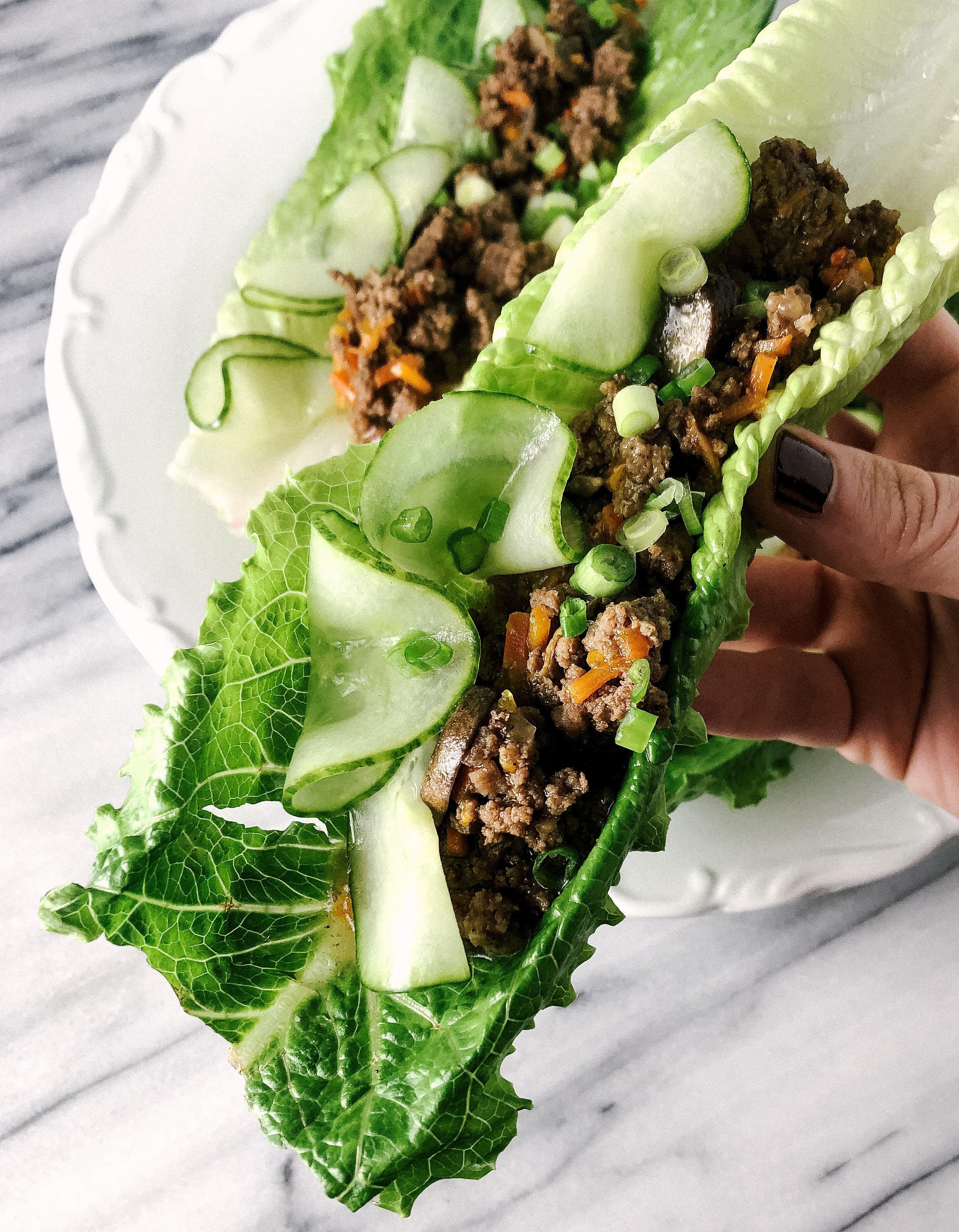 A new staple in my whole30 diet these instant pot beef lettuce wraps come together in very little time and pack a huge punch of flavor. Paired with the acid hit of pickled cucumbers these instant pot beef lettuce wraps makes the perfect low carb, paleo or whole30 meal.