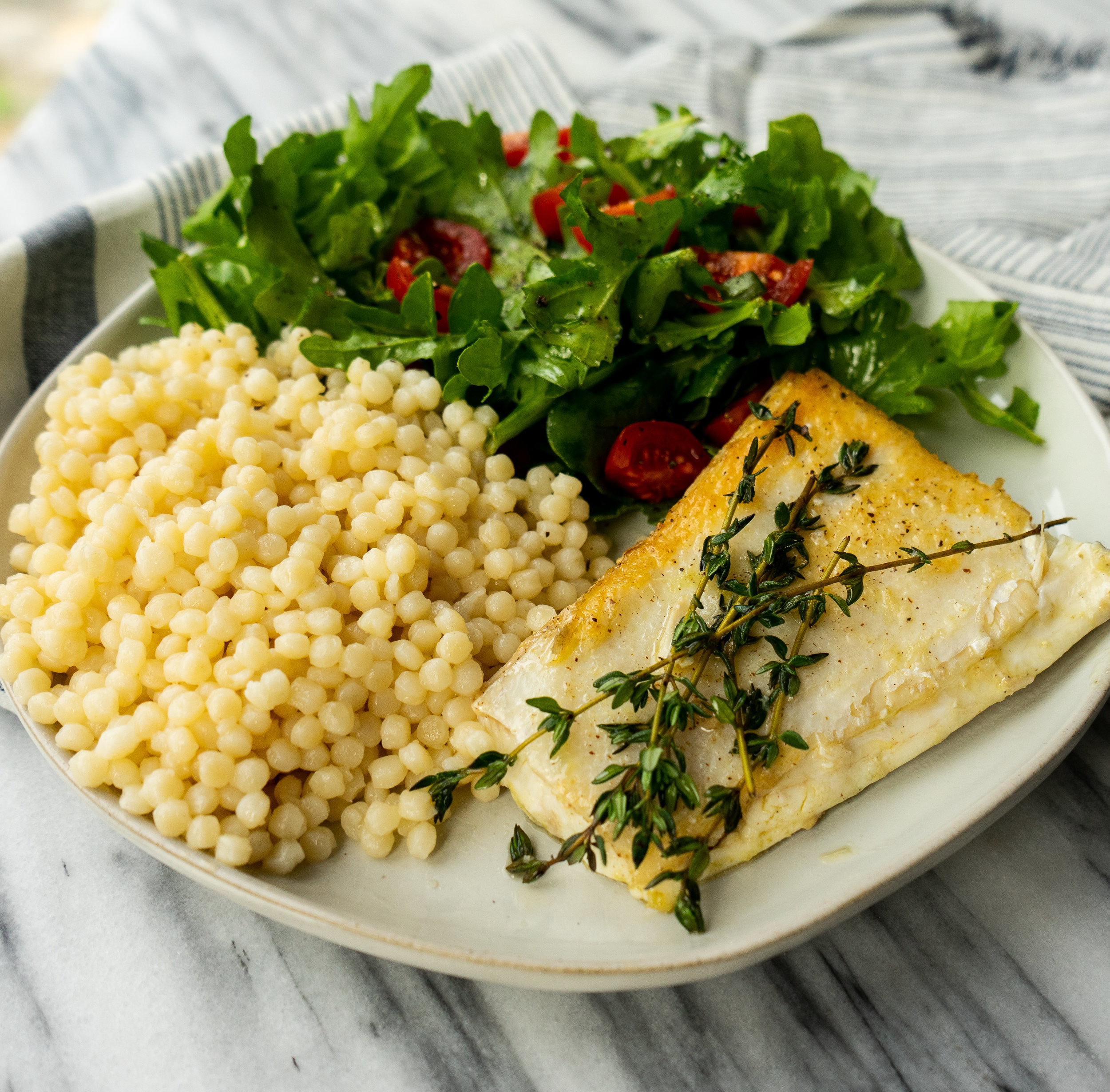 This pan roasted fish recipe is a perfect week night or date night dinner. Made with just a few simple ingredients this healthy meal comes together in less than 20 minutes.