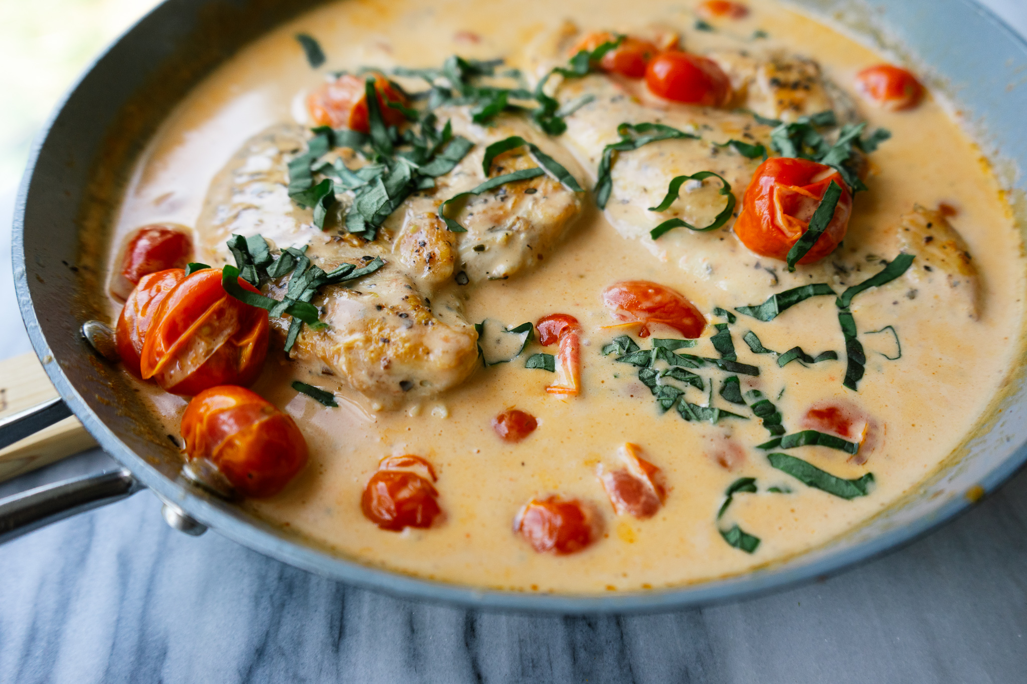 Creamy tomato basil chicken is a simple one pan, weeknight dinner that is perfect on its own or with rice or a bowl of pasta.