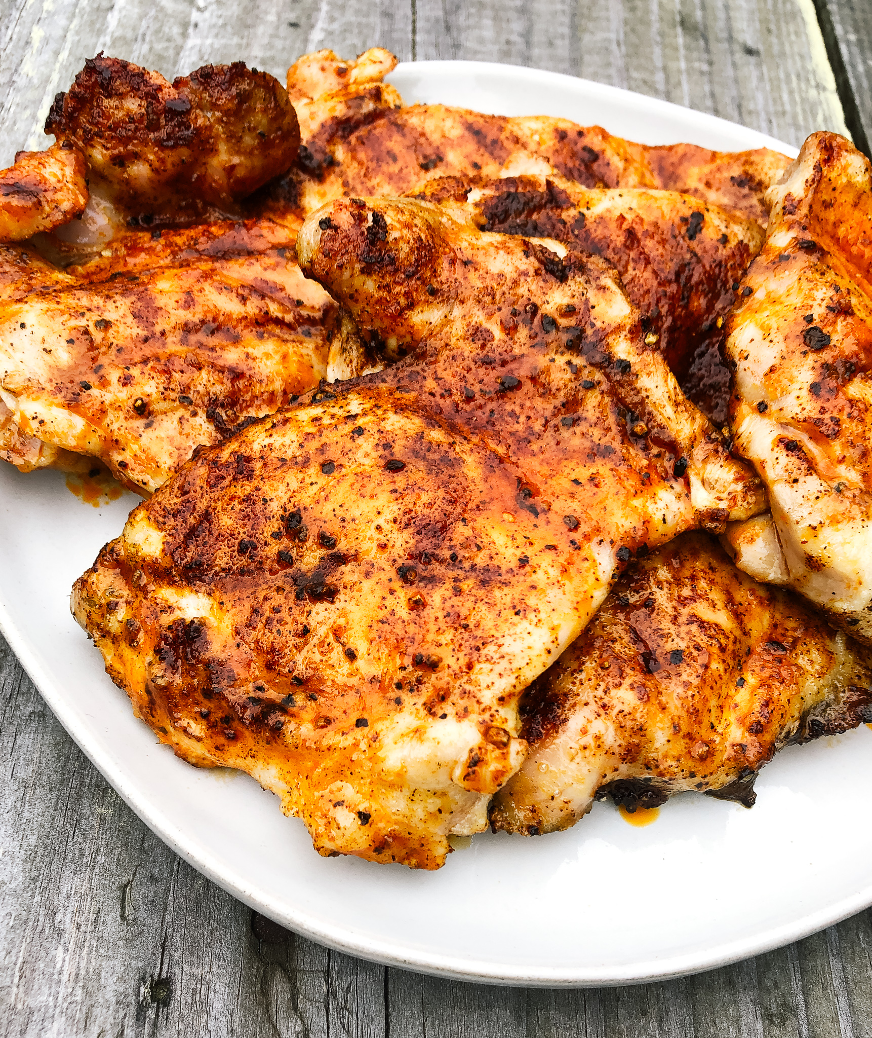 Whole30 Grilled buffalo chicken thighs bring all of the taste and flavor of traditional buffalo chicken wings, but with Whole30 and paleo ingredients plus way less mess! Its grilling season so its time to add this simple whole30 protein to your summer meal prep repetoire