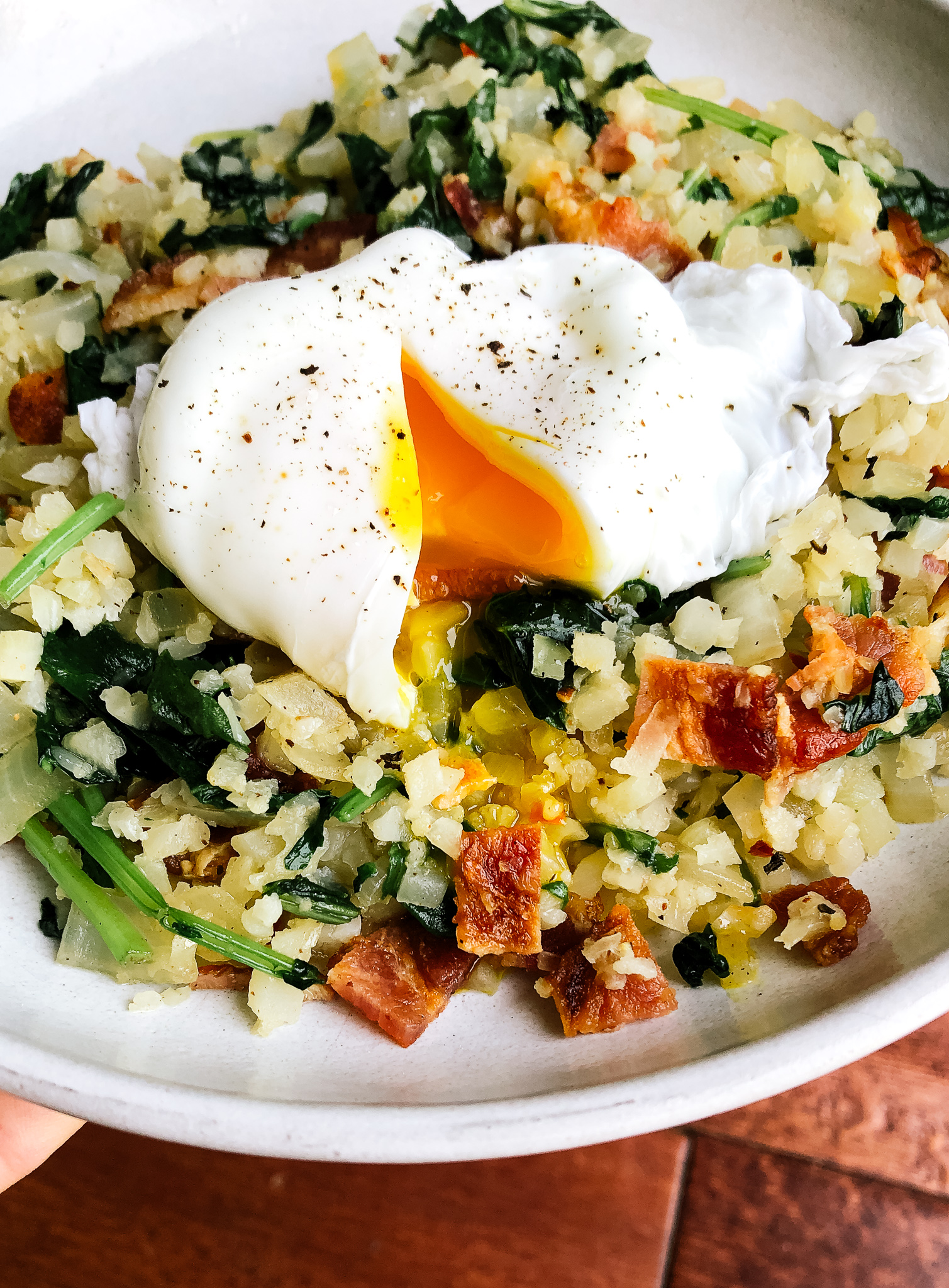 This cauliflower breakfast stir fry is low carb, paleo and whole30 friendly and so, so easy to throw together. It is quick, easy, satisfying and healthy all the things I look for in a paleo breakfast. This simple stir fry is perfect any time of day.