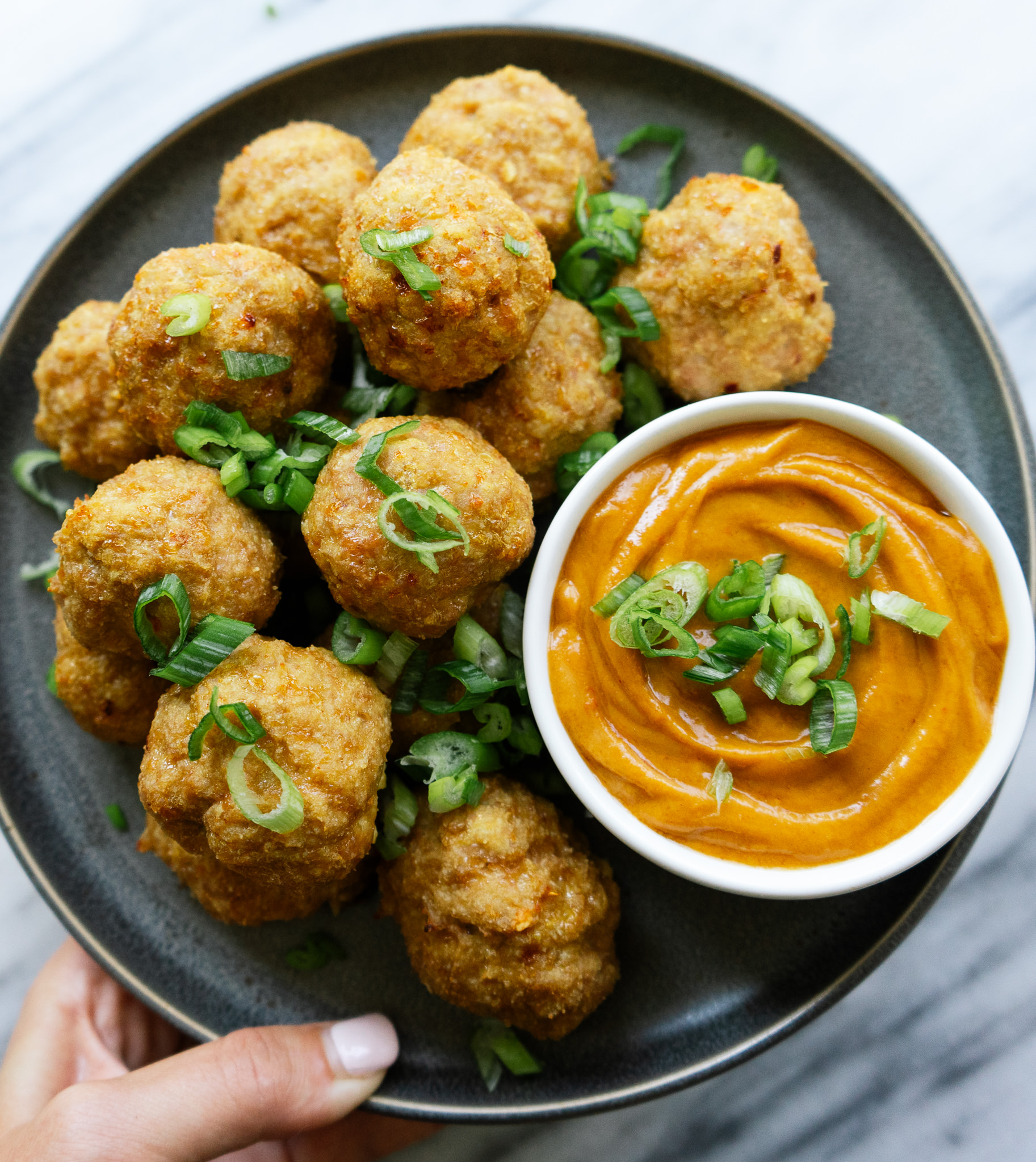 Sesame turkey meatballs with spicy peanut sauce is a delicious and simple low carb meal that can be a full dinner or a delicious appetizer. This flavorful dish comes together in less than 40 minutes. Make these meatballs for your next dinner or party!
