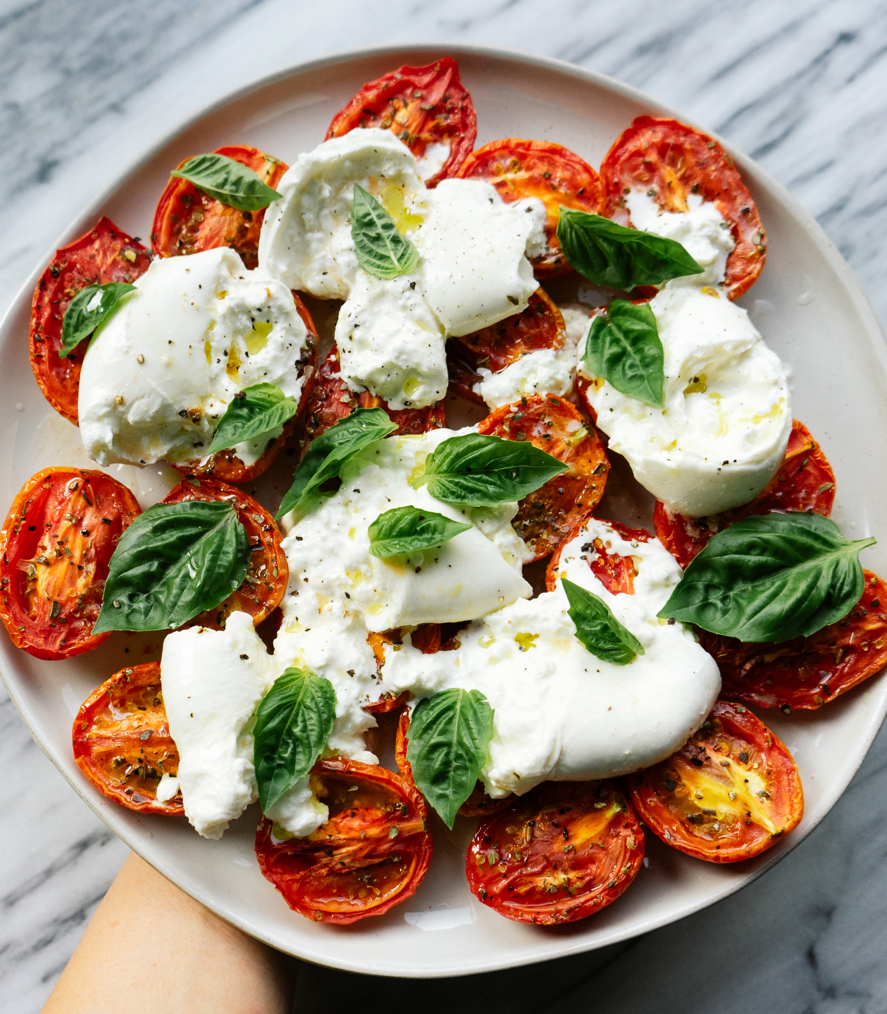 Looking for the perfect summer salad or side dish? Make this simple, healthy, and delicious slow roasted tomato and burrata salad.