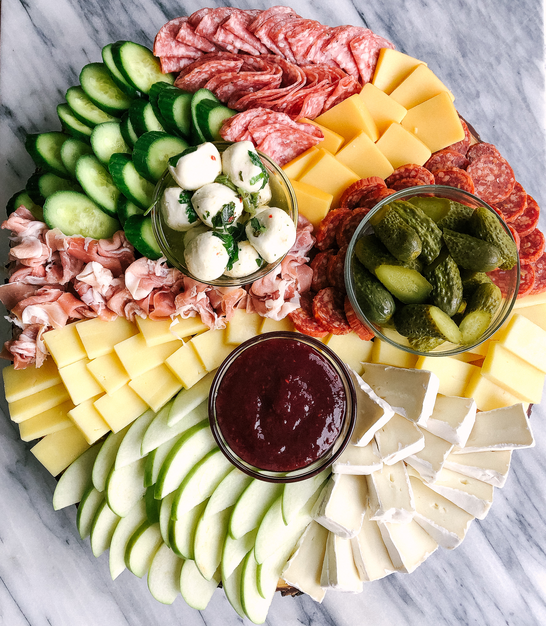 Use this guide to make an epic charcuterie board or cheese plate for your next holiday gathering or party with family and friends!