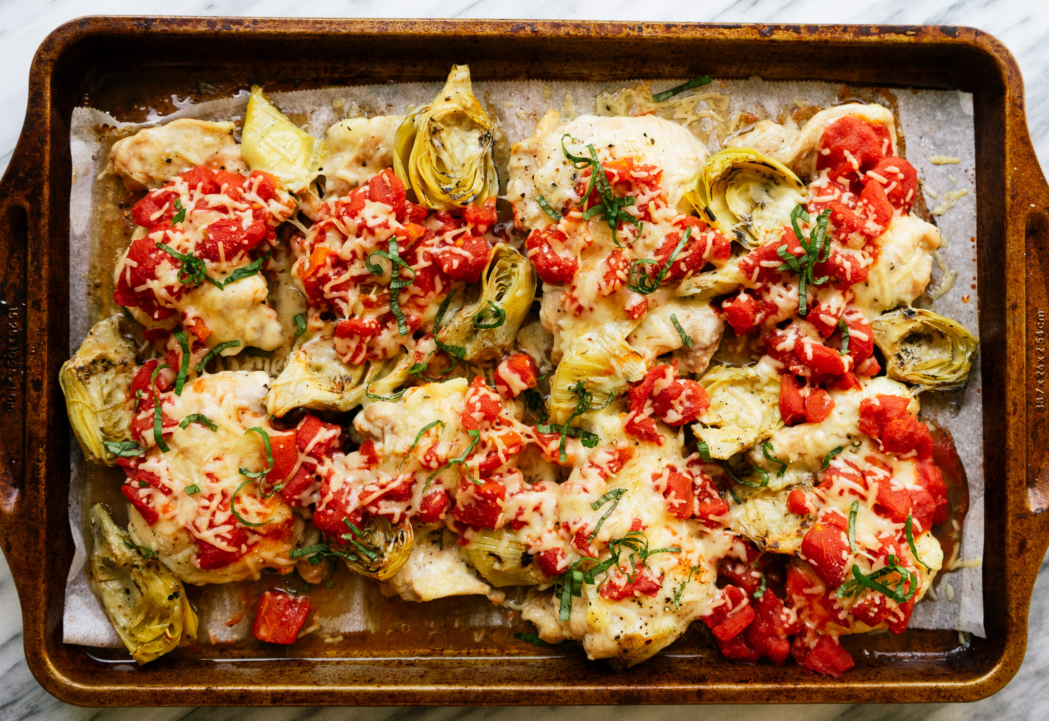 Sheet pan tomato and artichoke chicken is a delicious, simple, easy and healthy one pan meal. This easy weeknight dinner option is low carb friendly and comes together in about 30 minutes.