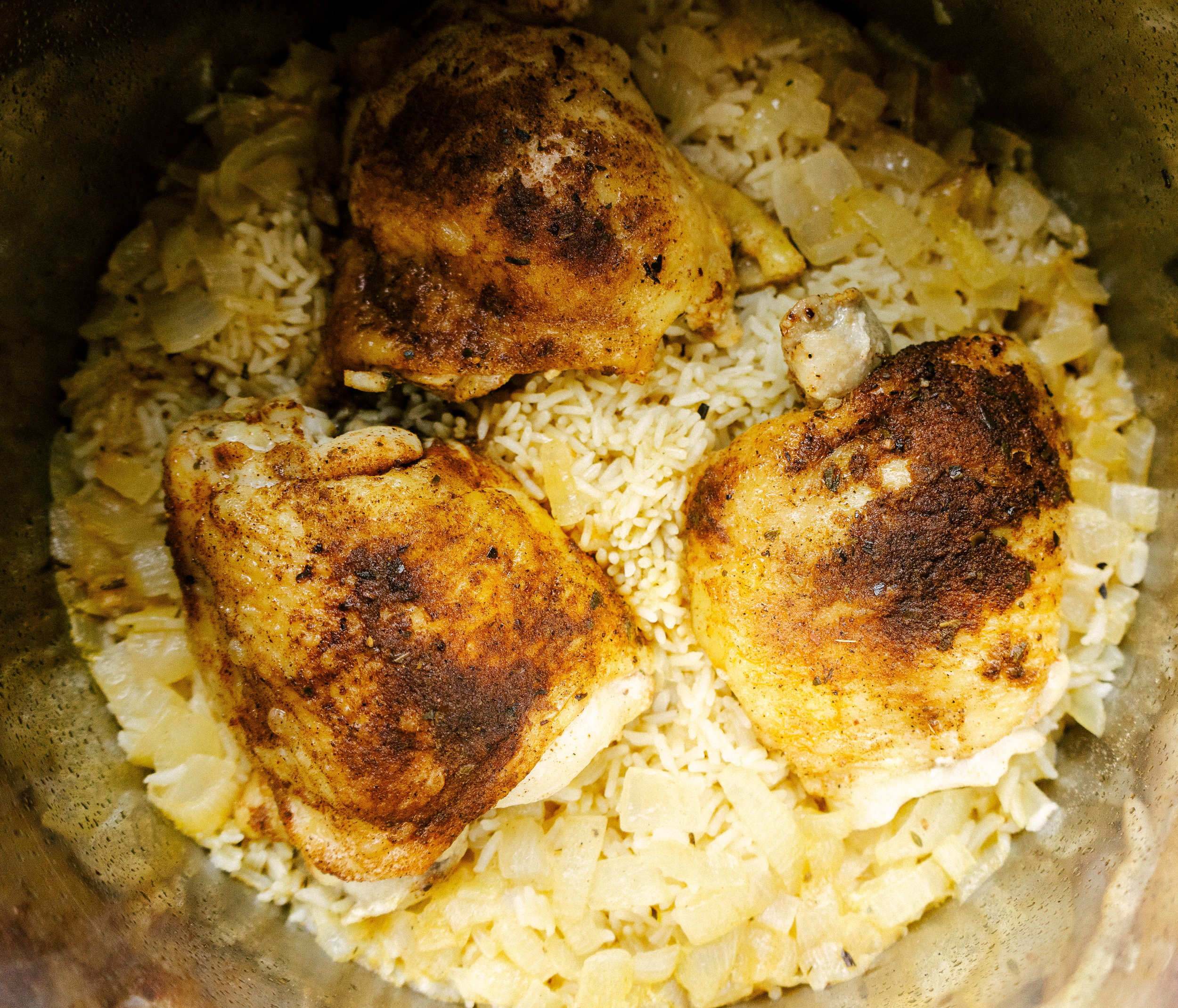 Instant pot seasoned chicken and rice is an easy and healthy one pan meal. This delicious dinner comes together in just an hour with basic ingredients and minimal clean up.
