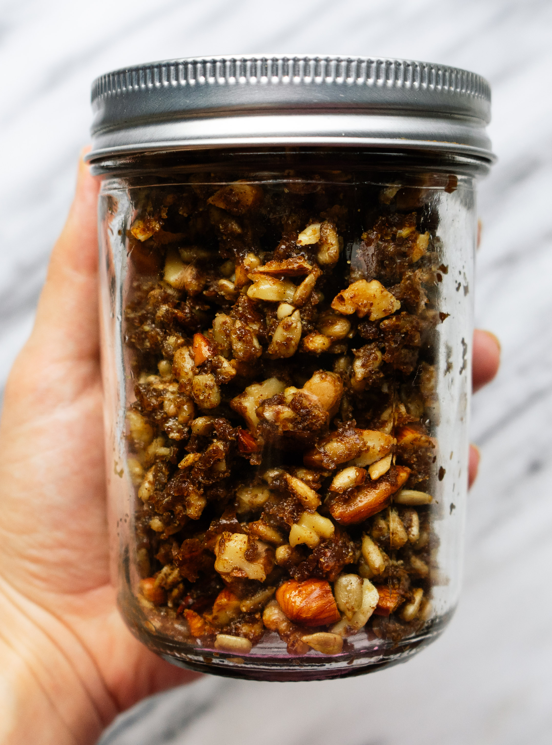 Pumpkin spice grain free granola is an easy and healthy recipe to get you into the fall mood. Bake a batch of this paleo granola and crumble it over yogurt or enjoy as a healthy snack on the go.