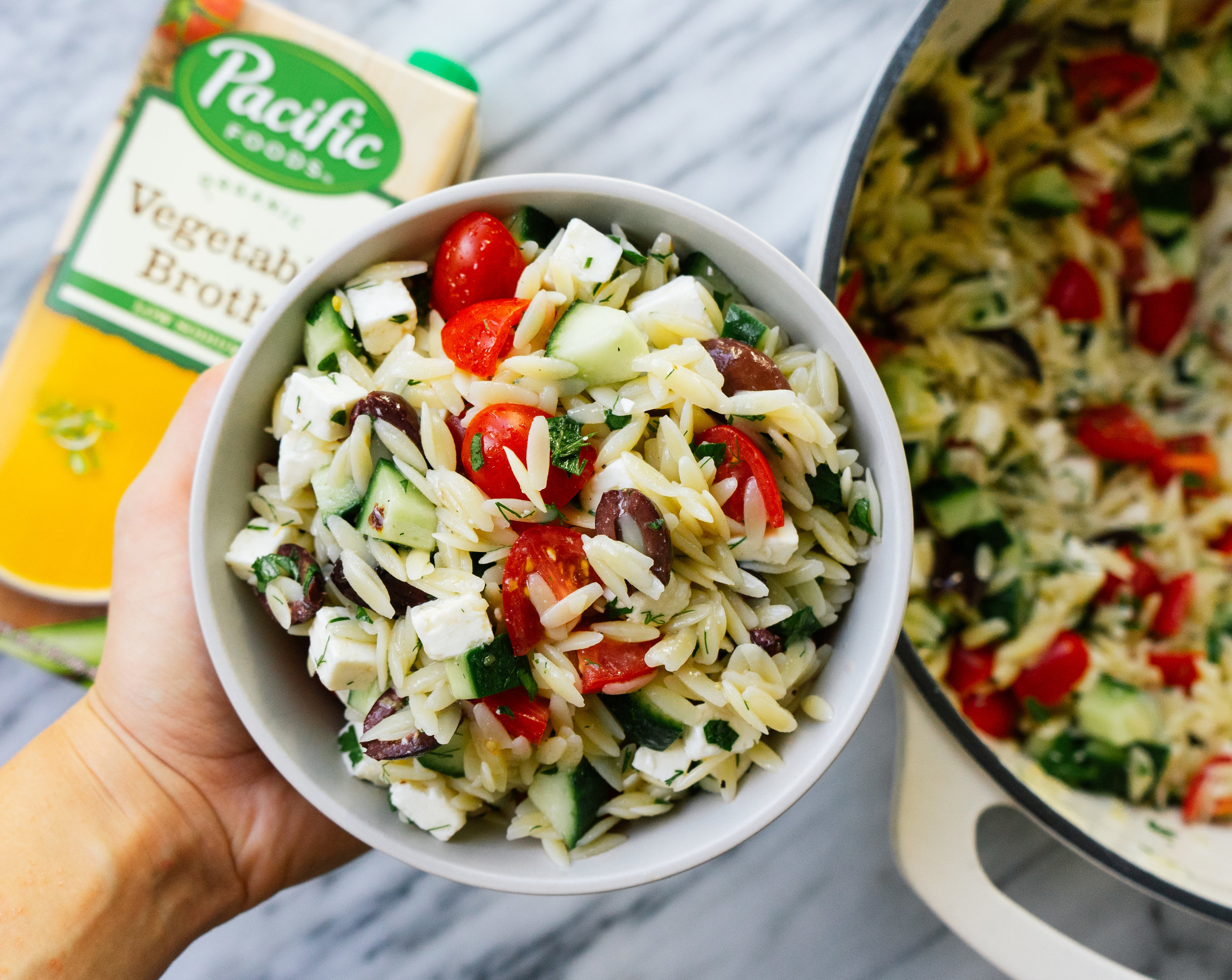 Mediterranean Orzo Salad made with Pacific Foods Low Sodium Vegetable Broth #sponsored This quick and easy recipe is perfect for that back-to-school and back-to-work meal prep. Cook this dish once and enjoy it all week!! This dish is bursting with flavor because it starts with the orzo cooked in Pacific Foods Low Sodium Vegetable Broth instead of just water and then is layered with lots of toppings, herbs, and spices!