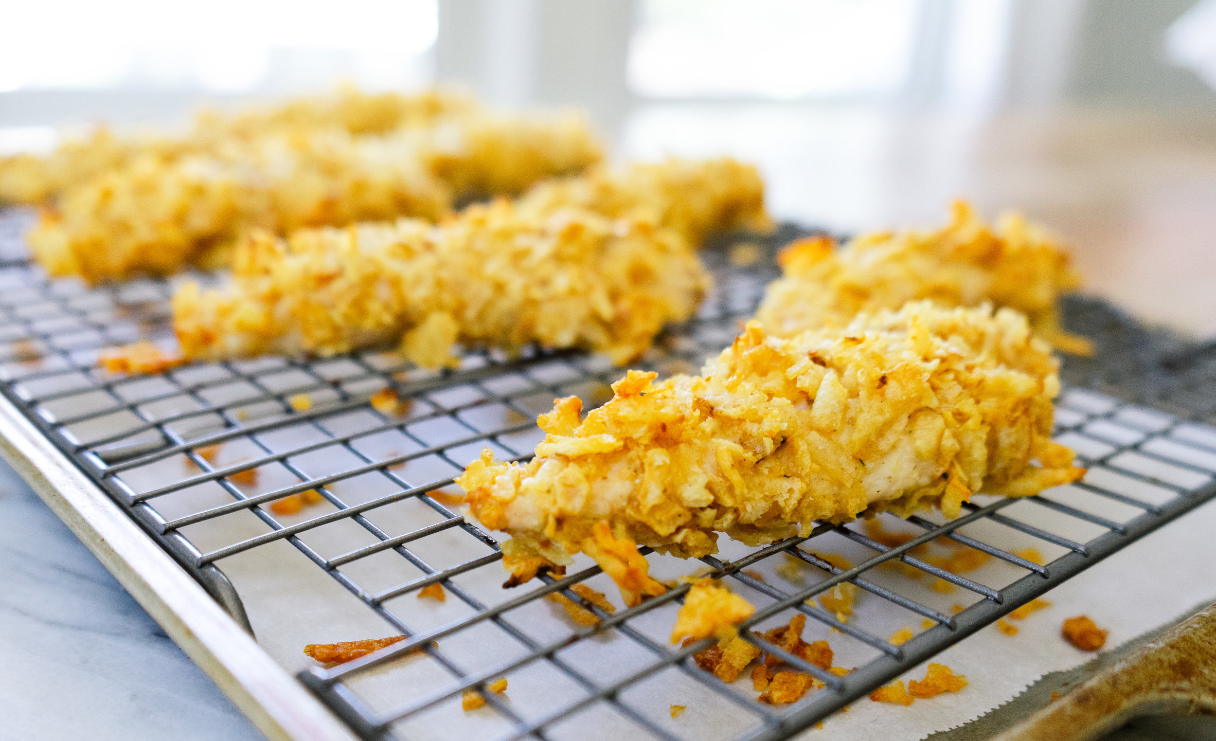 Potato chip chicken tenders are an easy and delicious way to get the taste of crispy, fried chicken tenders at home without having to deep fry. Make a batch of these crispy chicken tenders for your kids, for a party appetizer or for your next meal prep.