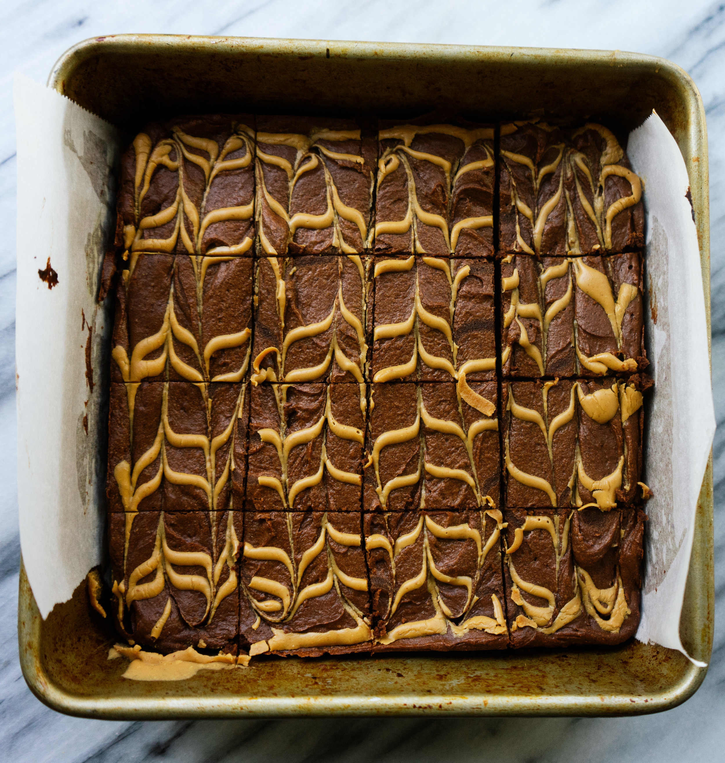 Flourless peanut butter brownies are a thick, fudgy and delicious paleo treat. Made with sweet potato and other healthy ingredients this grain free dessert is easy to make for a tasty and healthy paleo treat!