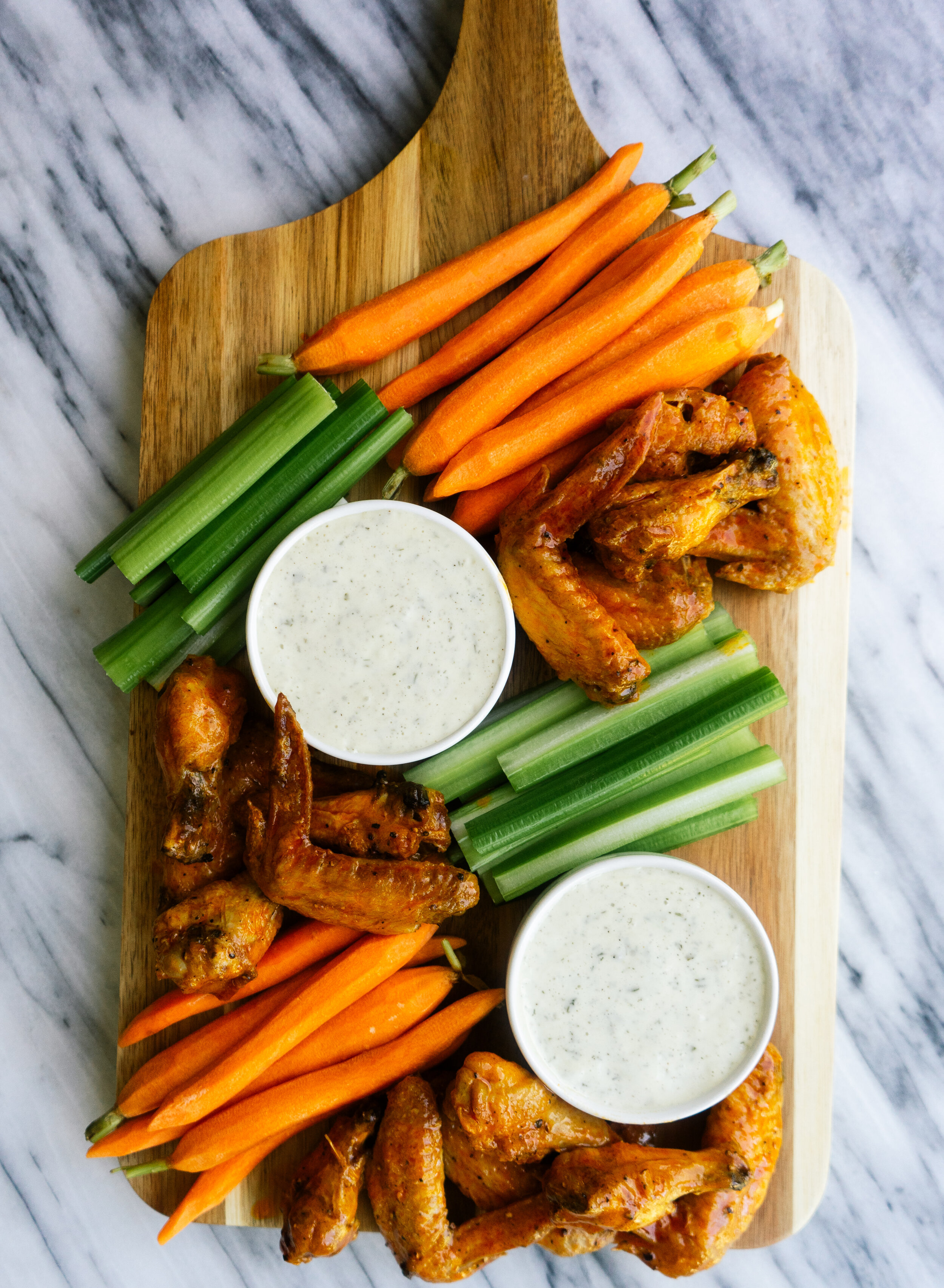 Make some Whole30, paleo and low carb buffalo wings in your air fryer! These delicious, simple and healthy buffalo wings can be made in less than 20 minutes with simple ingredients.
