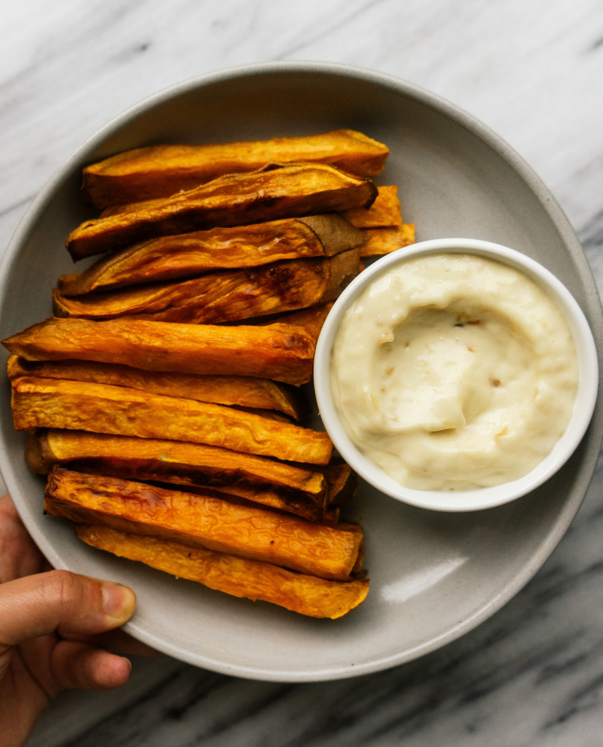 This Whole30 French Onion Dip is a healthy copy cat version of the Lay's french onion dip. This creamy dip is packed with flavor and made with healthy paleo and whole30 approved ingredients. Make this whole30 dip with sweet potato fries for a perfect healthy comfort food.