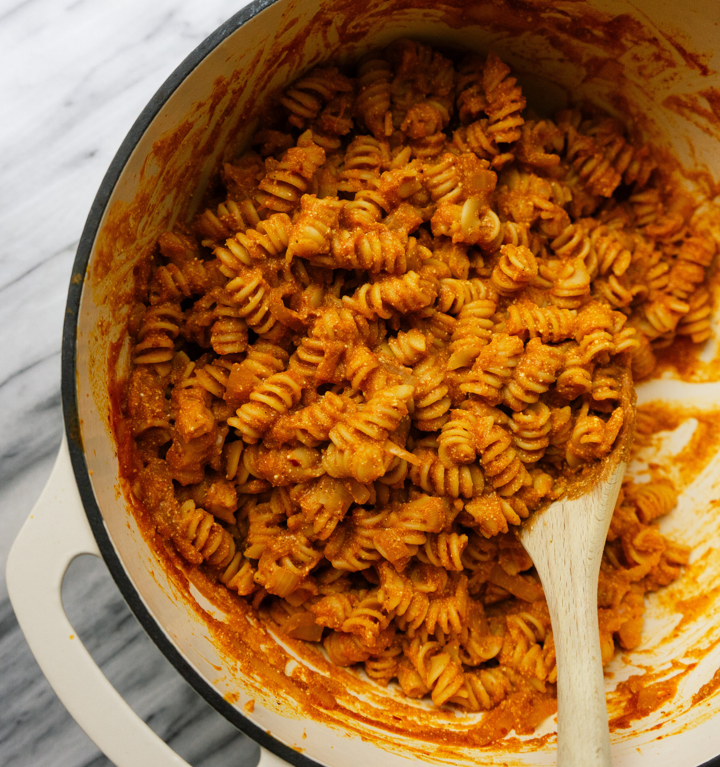 This spicy pumpkin one pot pasta is a quick and easy 30 minute meal. This savory pumpkin recipe is perfect for a fall weeknight dinner or to fuel your trick-or-treaters before they head out!