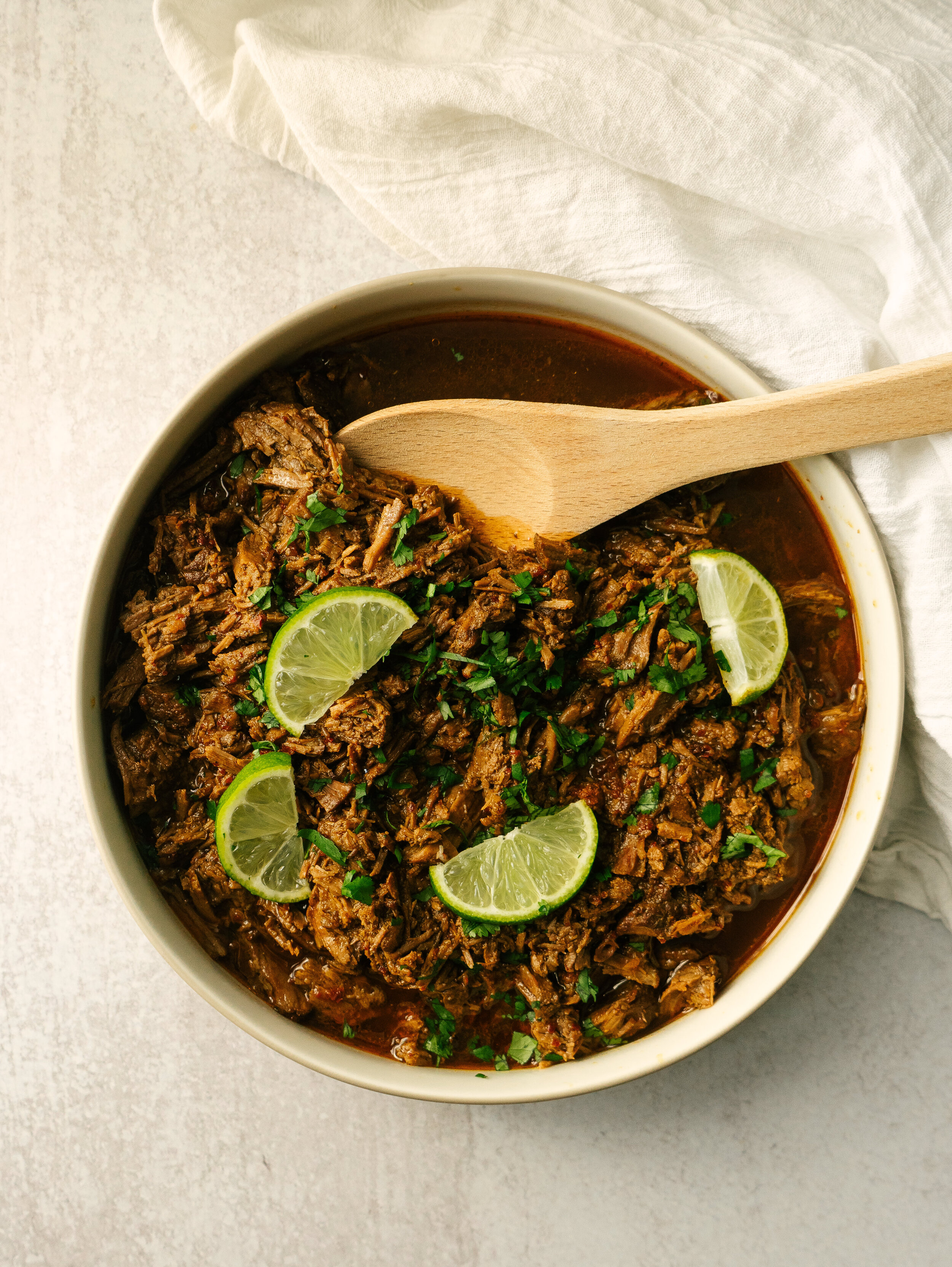 above view of instant pot barbacoa in a bowl