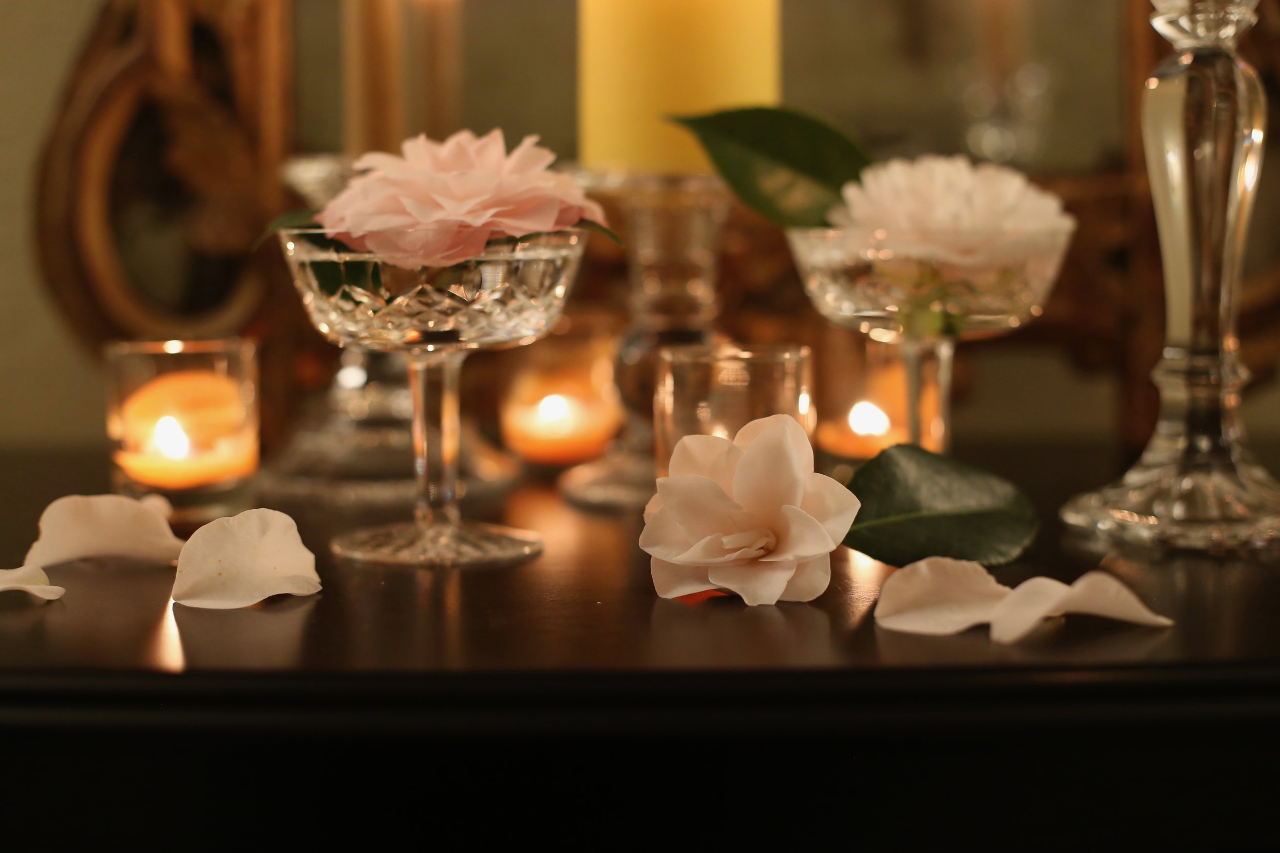 - These are camellias from my garden in Waterford glasses I found at a thrift store ($1.69 each YESSSSS) I gathered a mirror, candles, and votives from around the house and made a little tablescape on my dresser top.