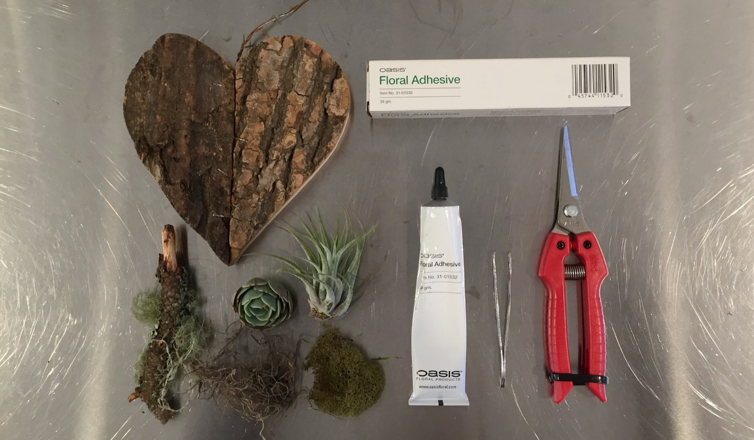 - You can find Oasis floral adhesive online. It allows moist things like live flowers and succulents to stick.  Collect some natural materials to collage onto a rigid base.