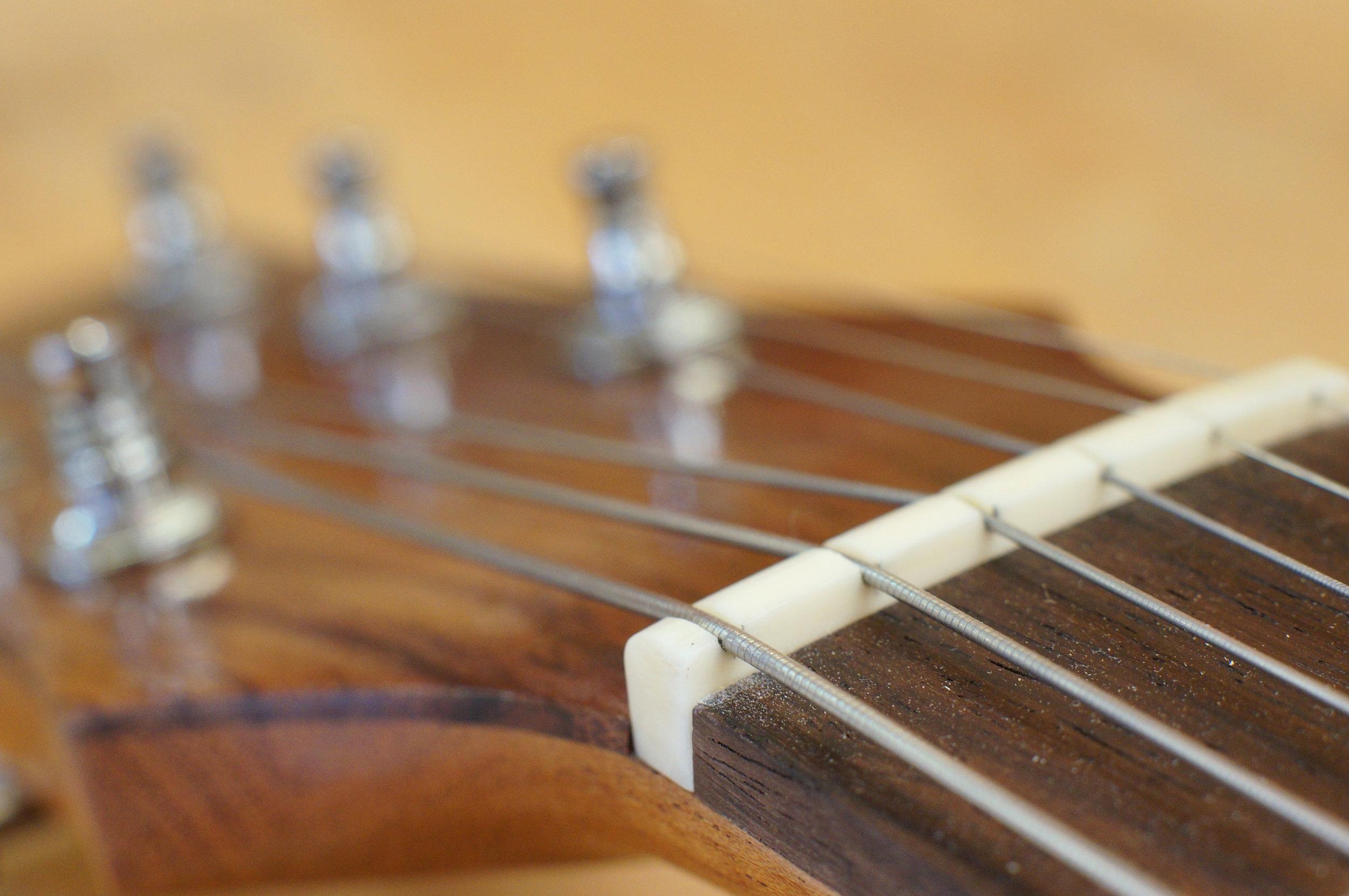 String slots filed deeper.JPG