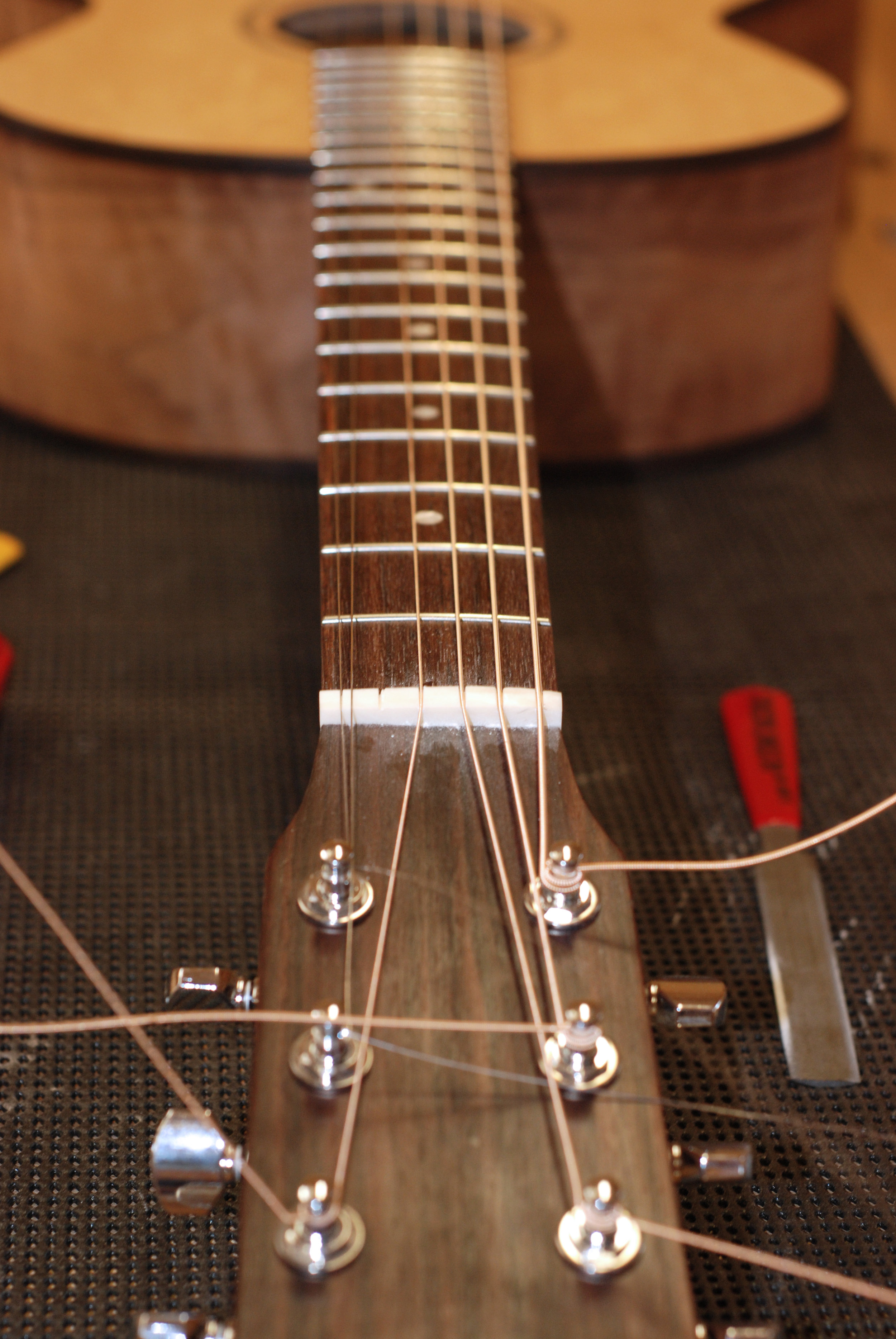 Nut being set up for strings with special nut slotting file.JPG