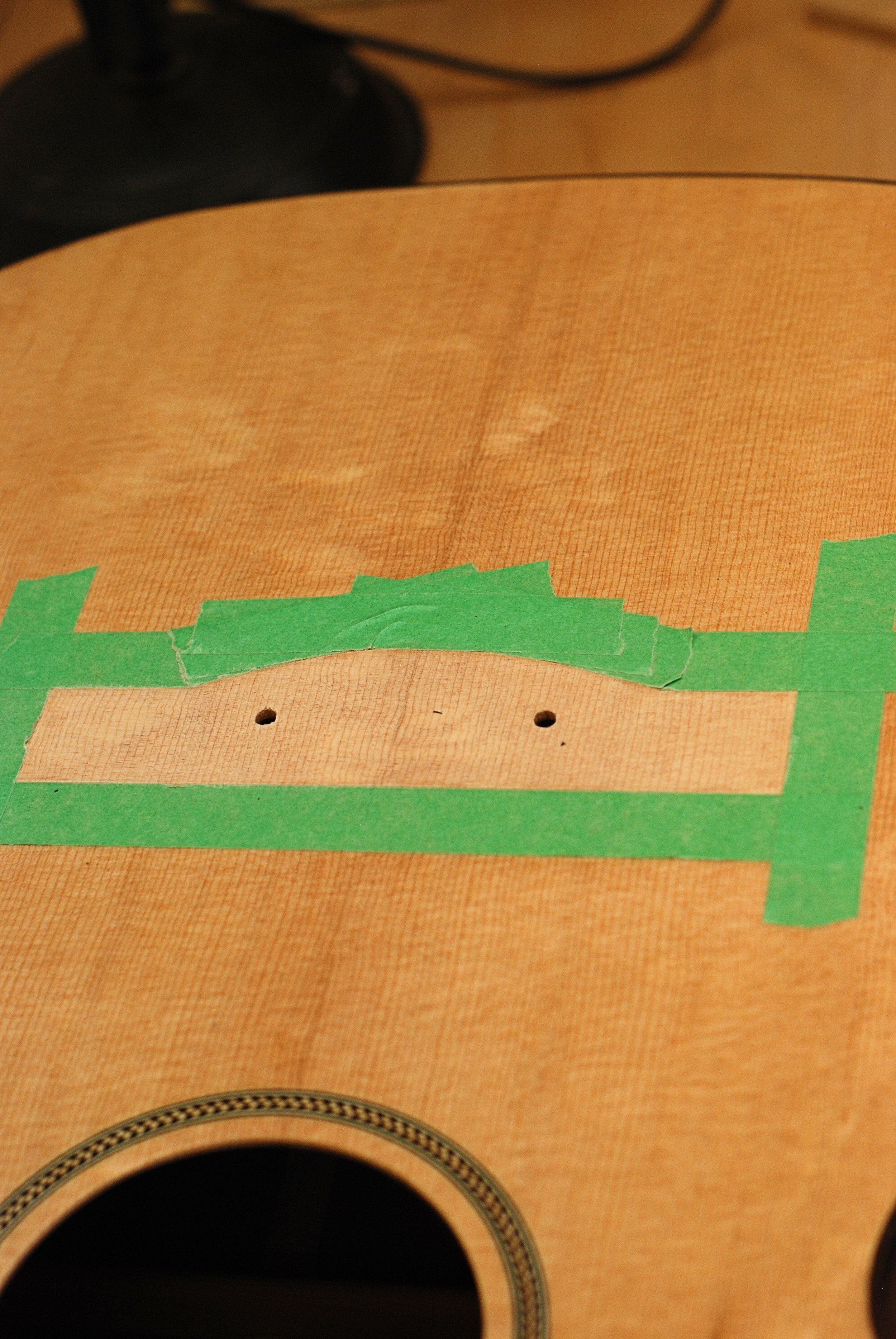 soundboard masked and bolt holes drilled prior to clamping.JPG