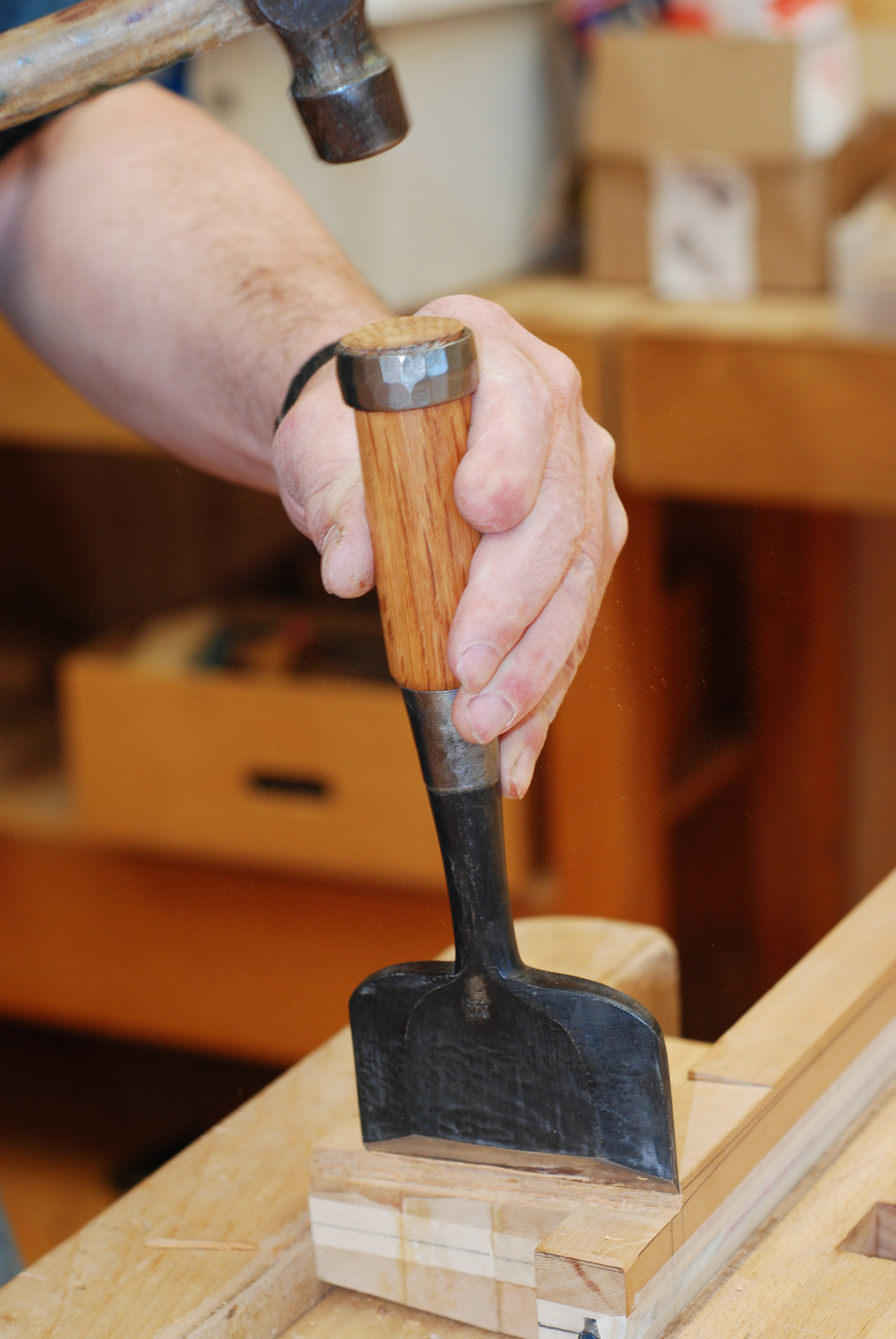 very wide chisel being used to pare back to line marking join to body.JPG