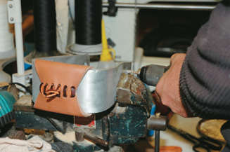 Drilling holes in stirrups