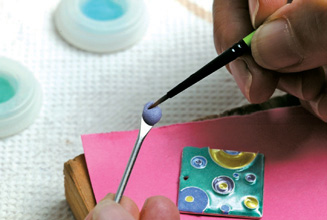 Pick up a small amount of enamel on the brush