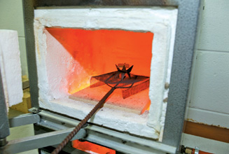 Place the piece in the kiln