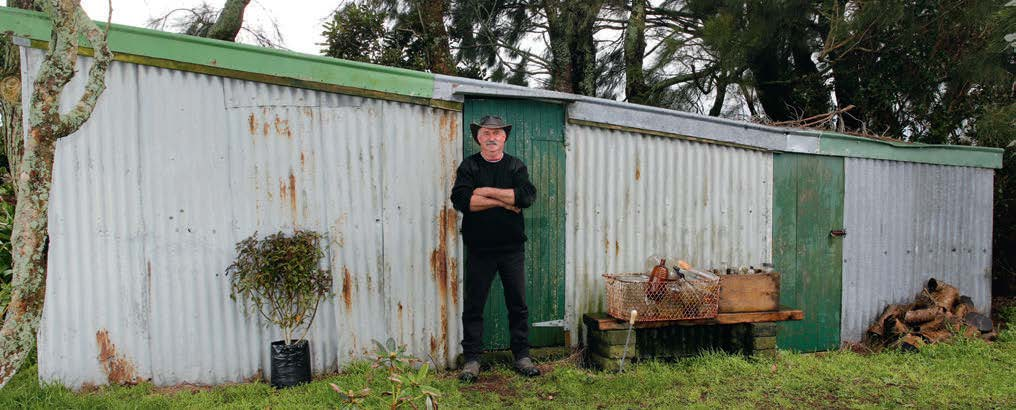 Gary and one of his sheds full of bikes and parts. Note the lean to on the lean to on the lean to.