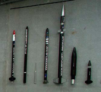 The previous test rockets hang on the wall.
