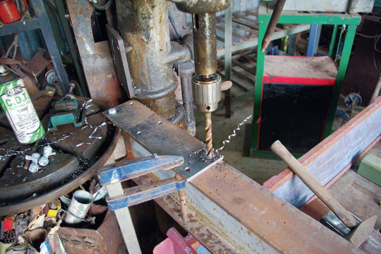 Stanchion plate drilled on I-Beam to match