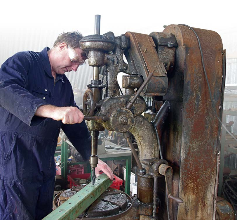 Drilling locking pin holes at 100mm centres on sliding stanchion