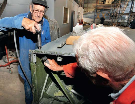 Riveting is a two-man job for Don Barr(left) and Mike Jackson