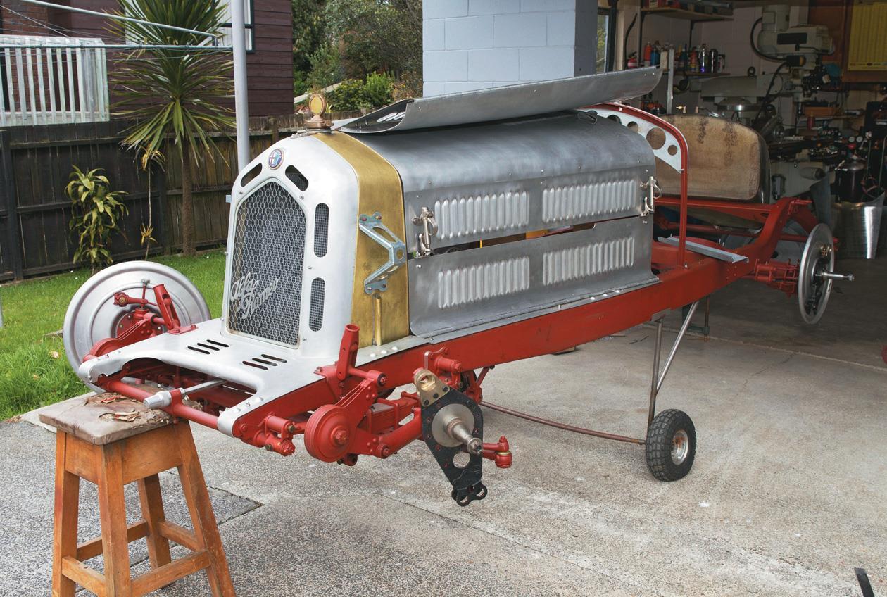 The body of a classic Alfa Romeo 8C takes shape in a Kiwi backyard.