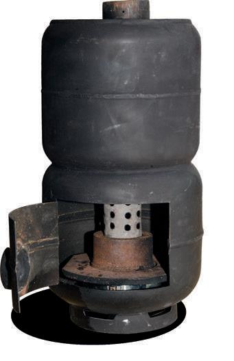 The Mighty Max has a   device in the base made   from an old brake drum   which helps to hold the   heat to vaporise the   waste oil dripping into   the interior. The burner  flue is in the centre.