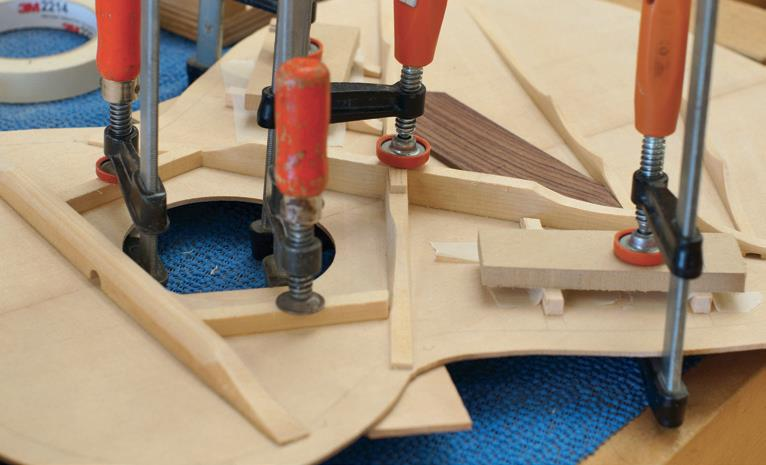 Small soundboard braces clamped on